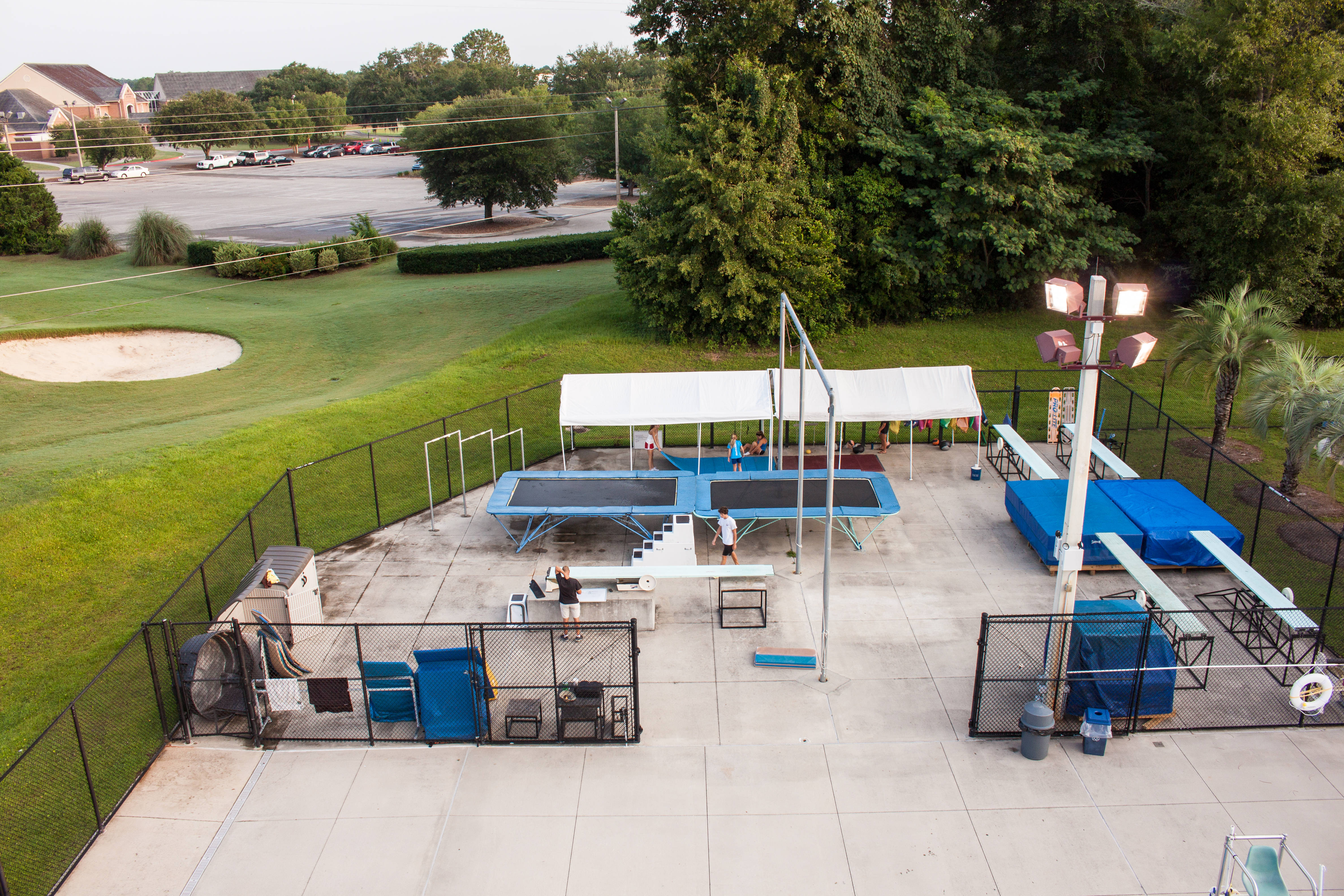 An aerial view of the diving dryland training center, which is equipped with four dry boards, ropes and a trampoline.