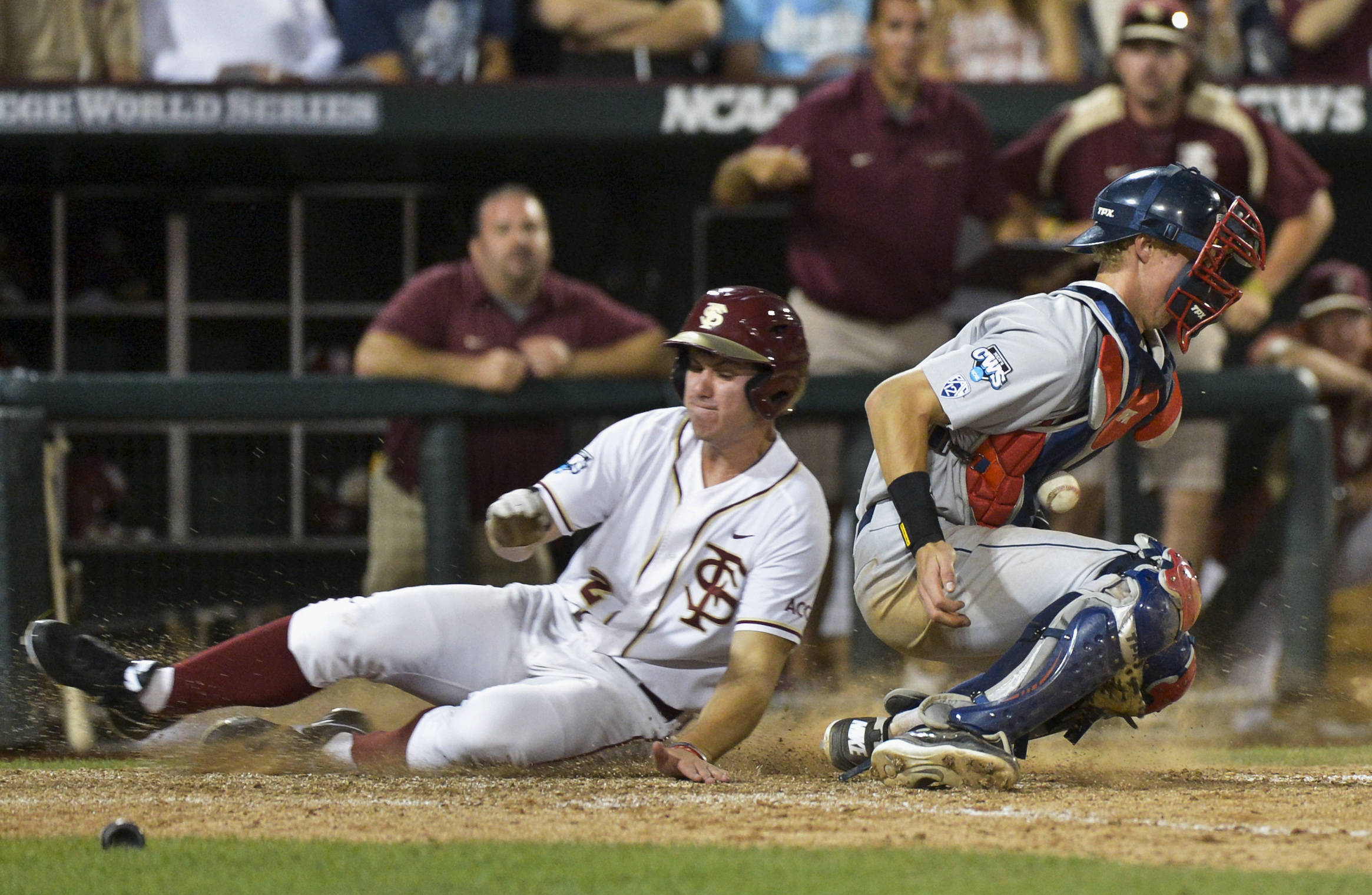 Florida State's Josh Delph, left, scores against Arizona catcher Riley Moore. (AP Photo/Ted Kirk)