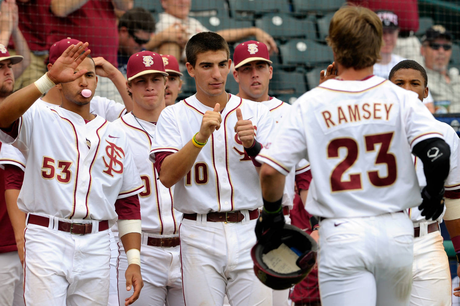 Florida State's James Ramsey (23) is congratulated on his homerun against Georgia Tech by his teammate during the ACC Baseball Championship May 23, 2012 in Greensboro, N.C. (Photo by Sara D. Davis/theACC.com)
