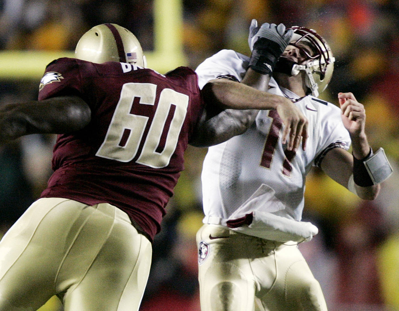Boston College's Ron Brace (60) hits Florida State quarterback Drew Weatherford after he let go of a pass during the first half of a football game in Boston on Saturday, Nov. 3, 2007. (AP Photo/Michael Dwyer)
