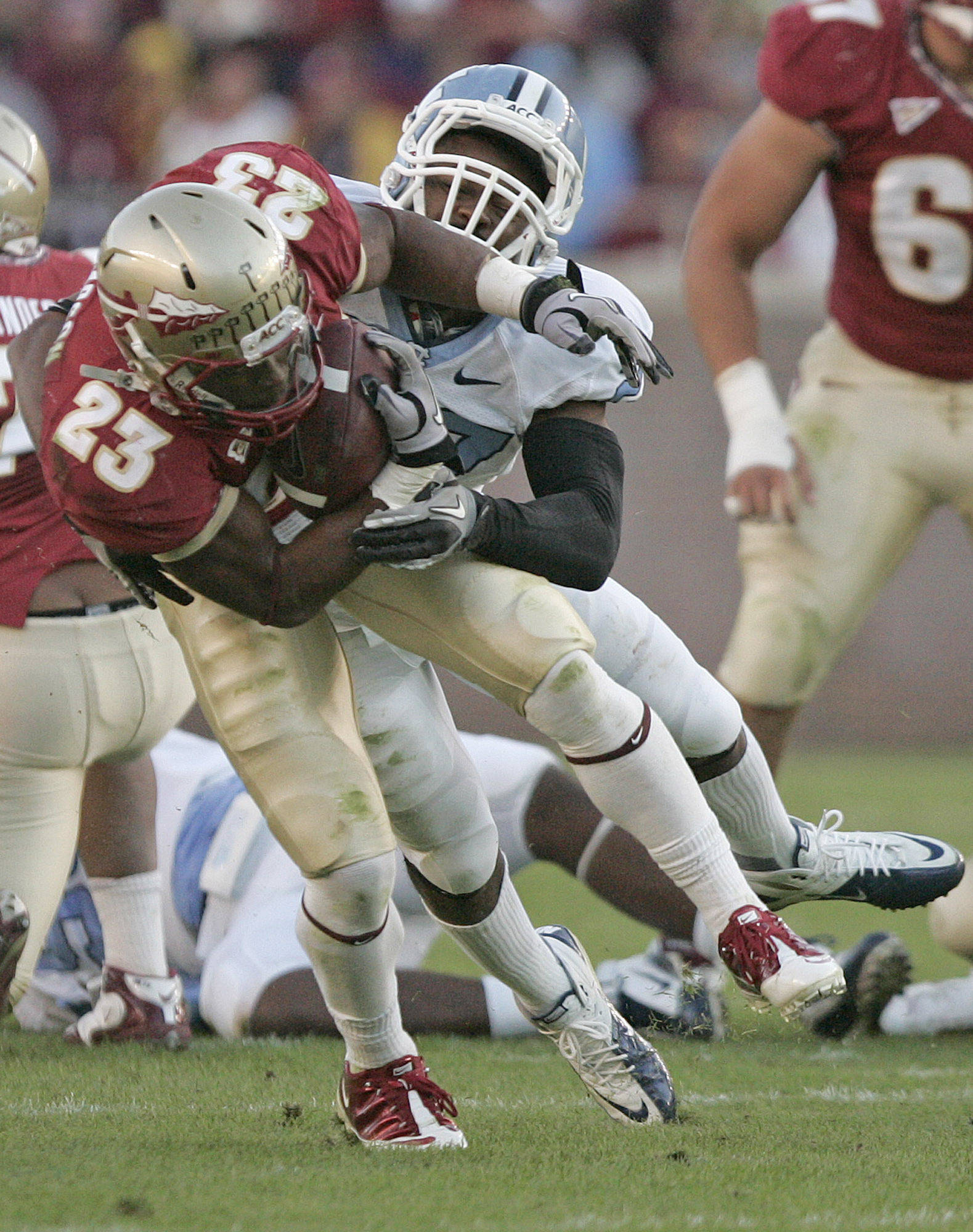 Florida State's Chris Thompson is tackled by North Carolina's Deunta Williams in the third quarter on Saturday. (AP Photo/Steve Cannon)