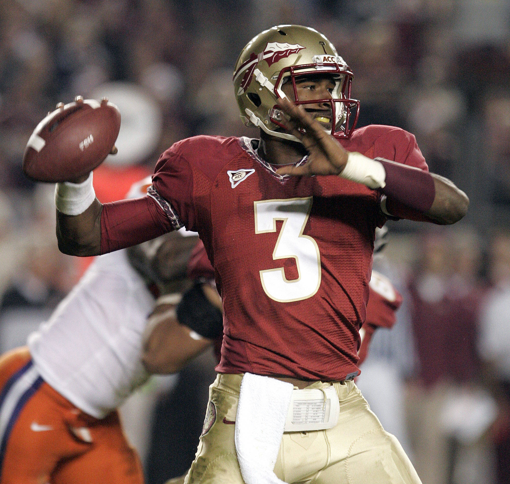 Florida State's EJ Manuel attempts a pass against Clemson's defense in the second quarter of an NCAA college football game on Saturday, Nov. 13, 2010, in Tallahassee, Fla.(AP Photo/Steve Cannon)