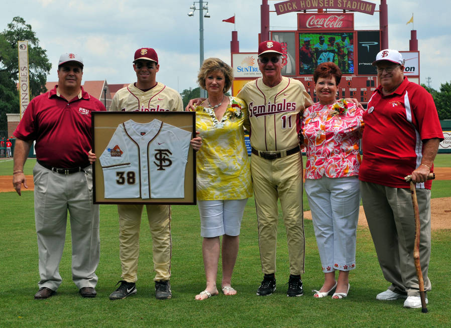 Stephen Cardullo with family and head coach Mike Martin on Senior Day.