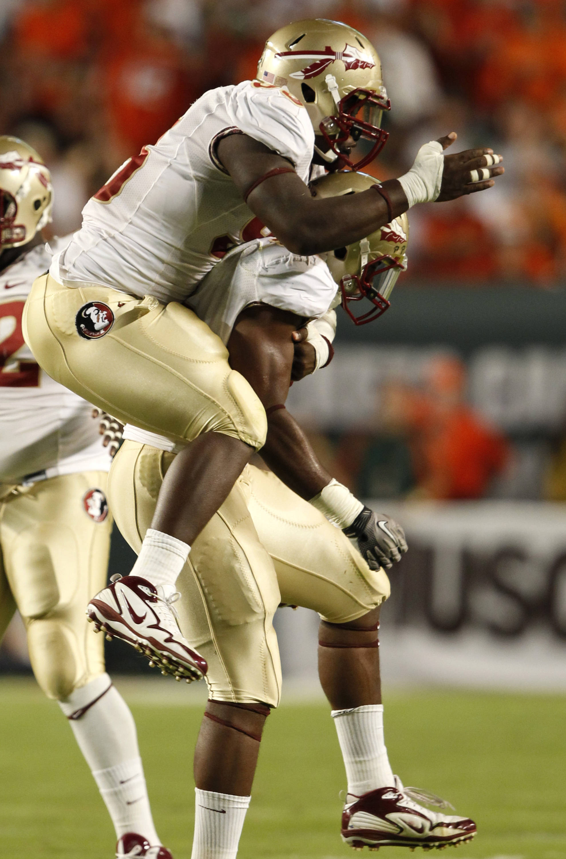 Florida State defensive tackle Everett Dawkins celebrates with defensive end Markus White after White sacked Miami quarterback Jacory Harris.