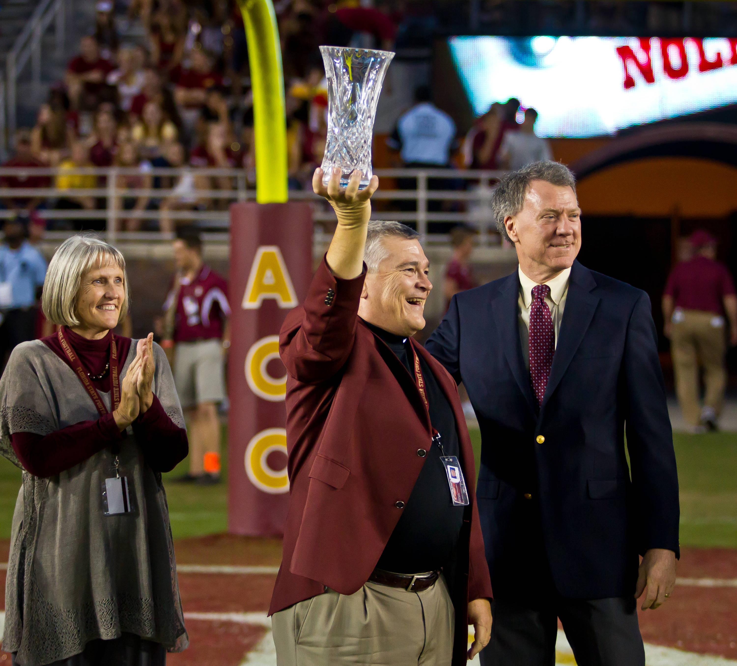 Eric Barron holds up FSU's Director's Cup trophy.