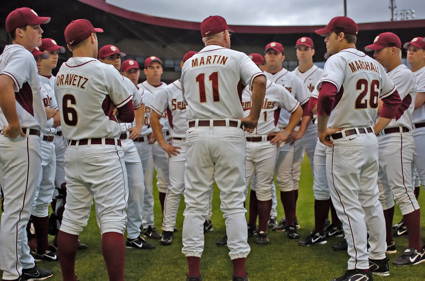 Head coach Mike Martin huddles with the team