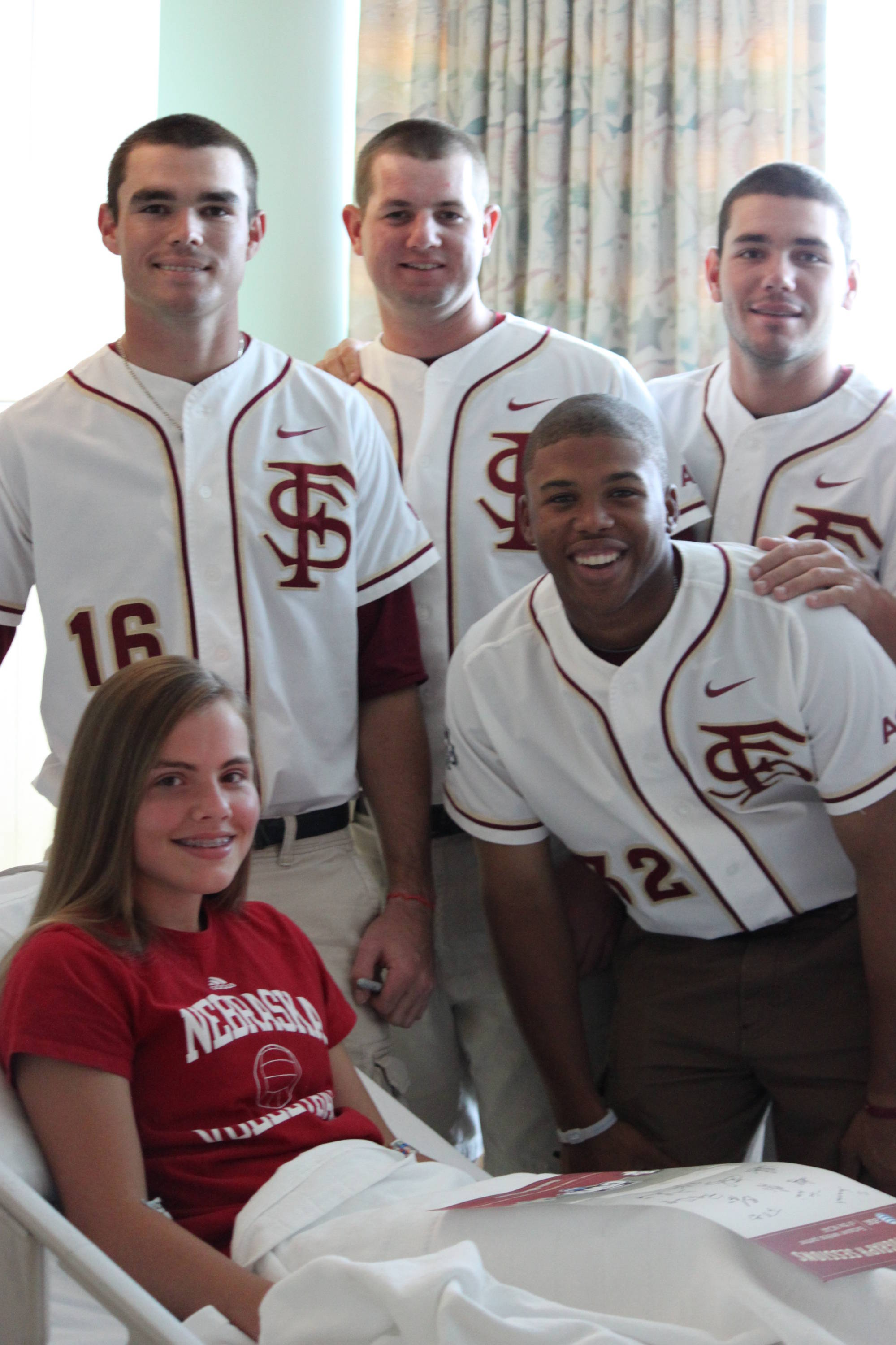 Jayce Boyd, Daniel Bennett, Robby Scott and Sherman Johnson on a visit to the Children's Hospital in Omaha