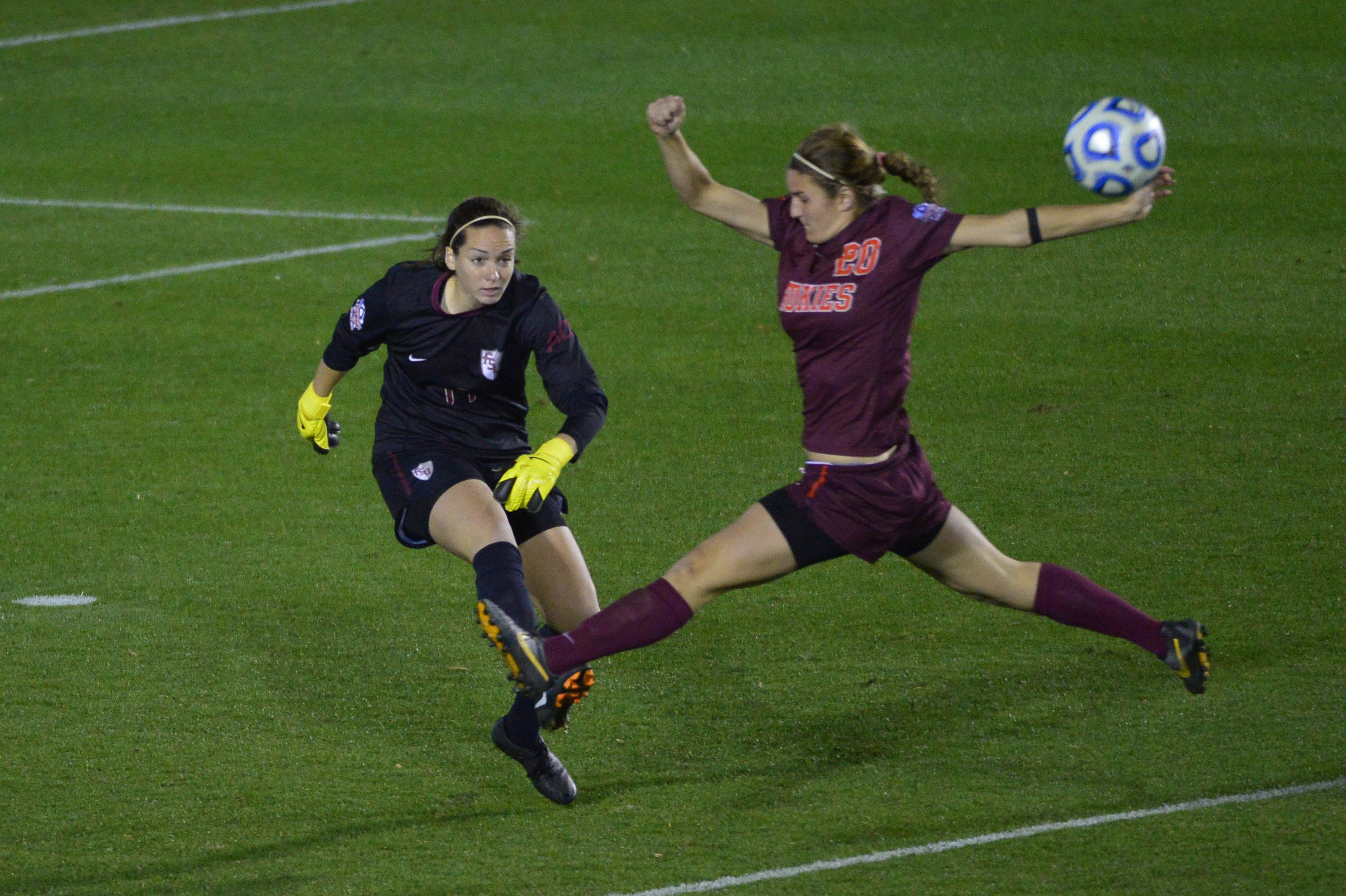 Dec 6, 2013; Cary, NC, USA; Florida State Seminoles goalkeeper Kelsey Wys (19) clears the ball as Virginia Tech Hokies forward Murielle Tiernan (20) tries to block in the second half. The Seminoles defeated the Hokies 3-2 at WakeMed Soccer Park. Mandatory Credit: Bob Donnan-USA TODAY Sports