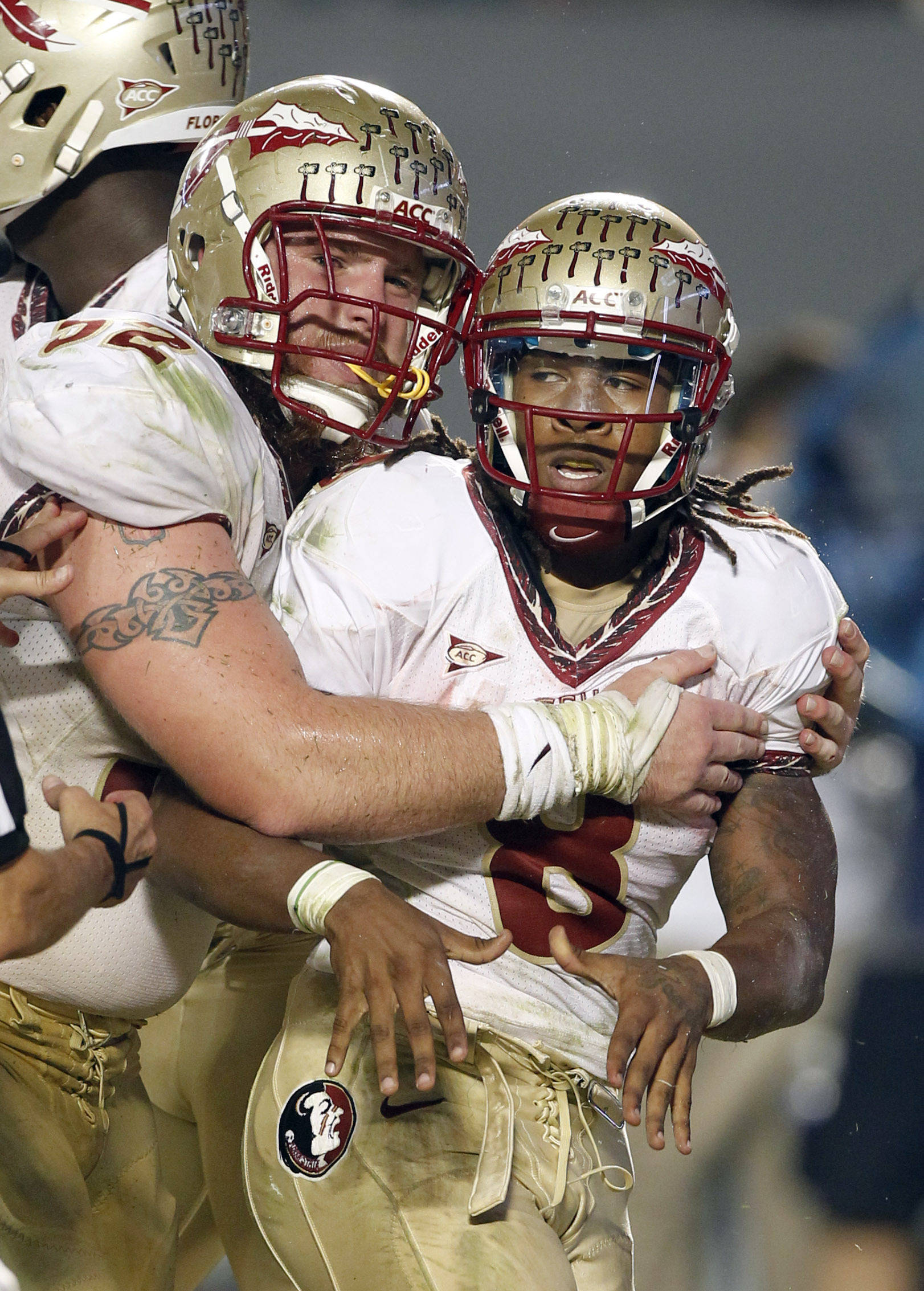 Florida State running back Devonta Freeman (8) is congratulated by Bryan Stork (52) after Freeman scored a touchdown against Miami during the second half of an NCAA college football game in Miami, Saturday, Oct. 20, 2012. Florida State won 33-20. (AP Photo/Alan Diaz)