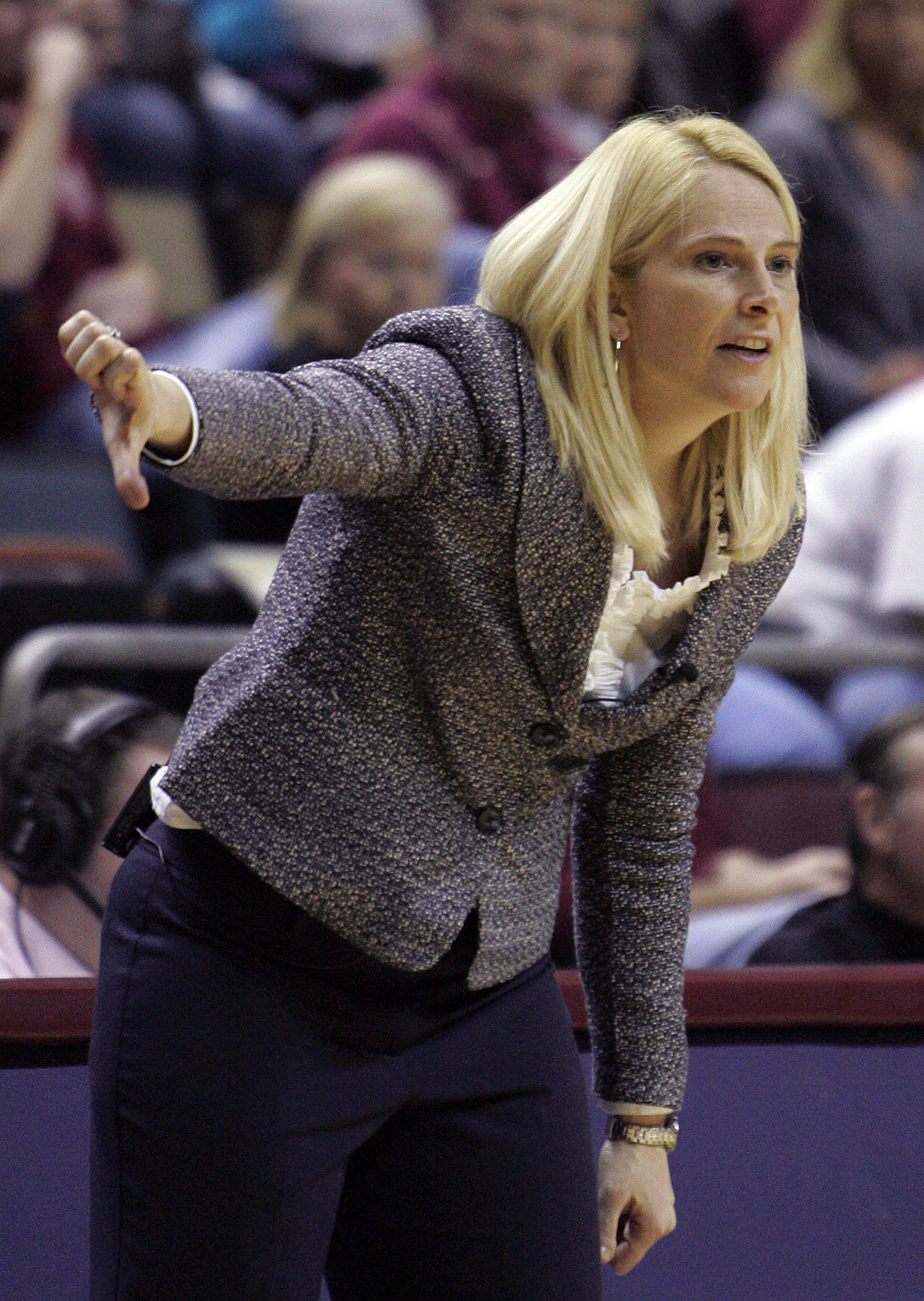 Maryland head coach Brenda Freese gestures to her team in the second half of an NCAA college basketball game against Maryland on Monday, Jan. 2, 2012, in Tallahassee, Fla. Maryland won 91-70. (AP Photo/Steve Cannon)