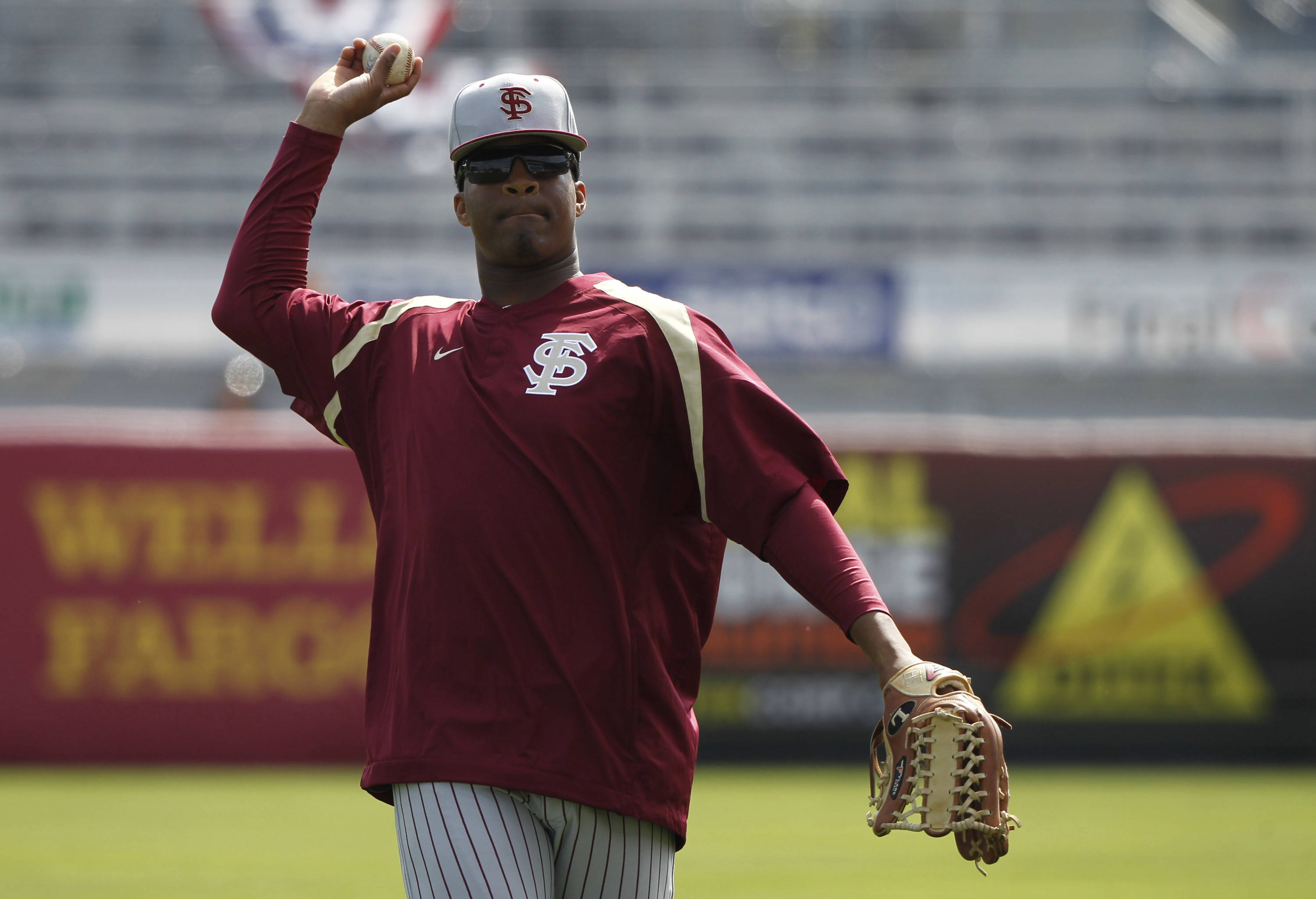 Feb 25, 2014; Tampa, FL, USA; Florida State Seminoles pitcher/outfielder Jameis Winston (44) works out prior to the game against the New York Yankees at George M. Steinbrenner Field. Mandatory Credit: Kim Klement-USA TODAY Sports