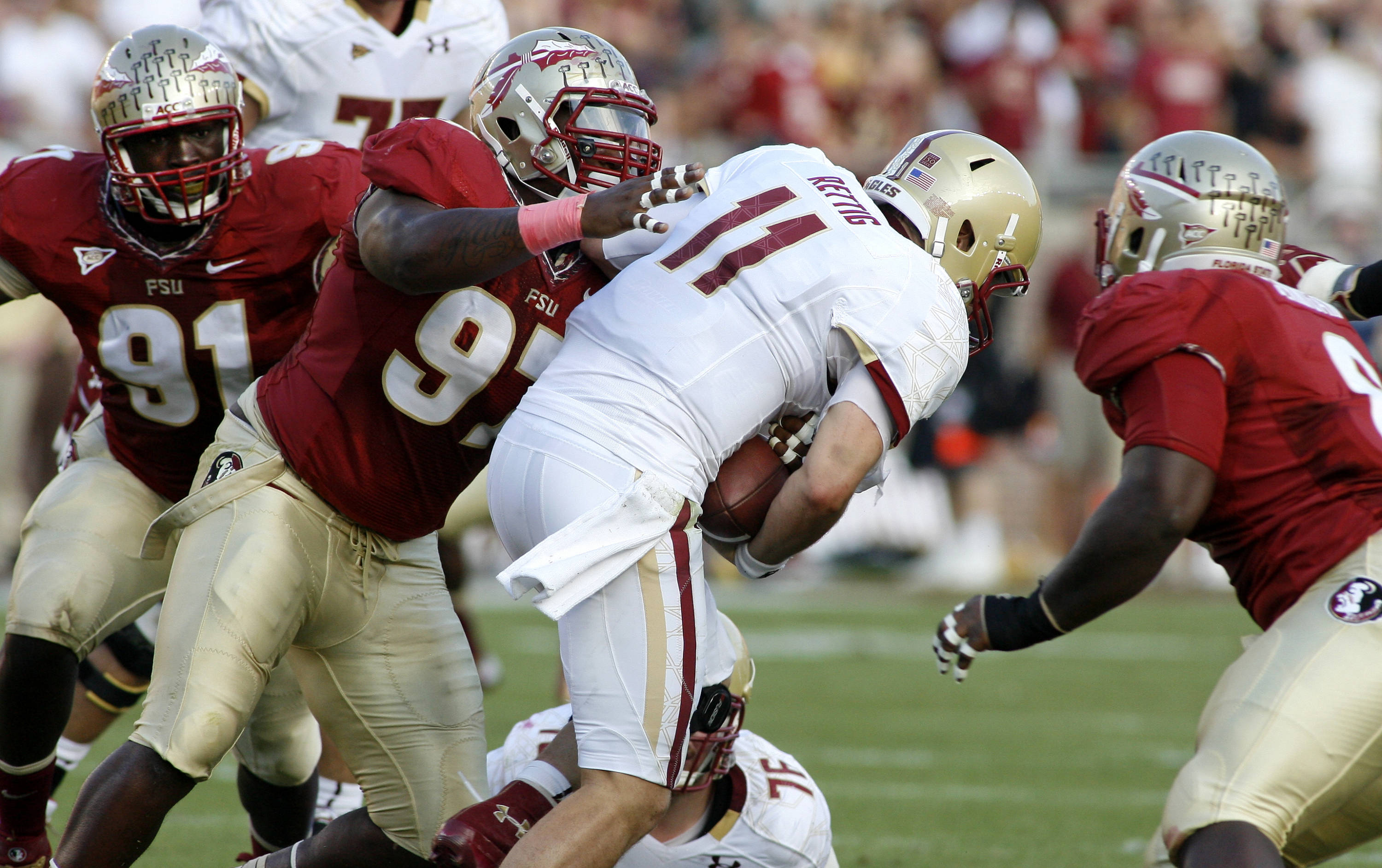 Florida State defensive tackle Demonte McAllister (97) and defensive tackle Timmy Jernigan, right, sack Boston College quarterback Chase Rettig (11) in the first quarter. (AP Photo/Phil Sears)