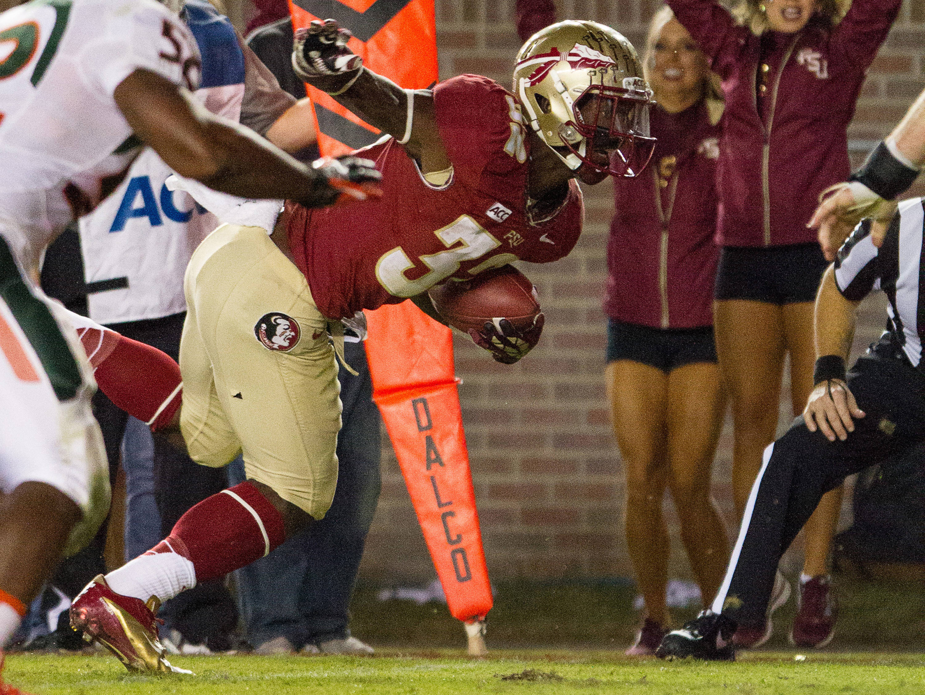 James Wilder, Jr. (32) dives towards the end zone for a touchdown during FSU football's 41-14 win over Miami on Saturday, November 2, 2013 in Tallahassee, Fla. Photo by Michael Schwarz.
