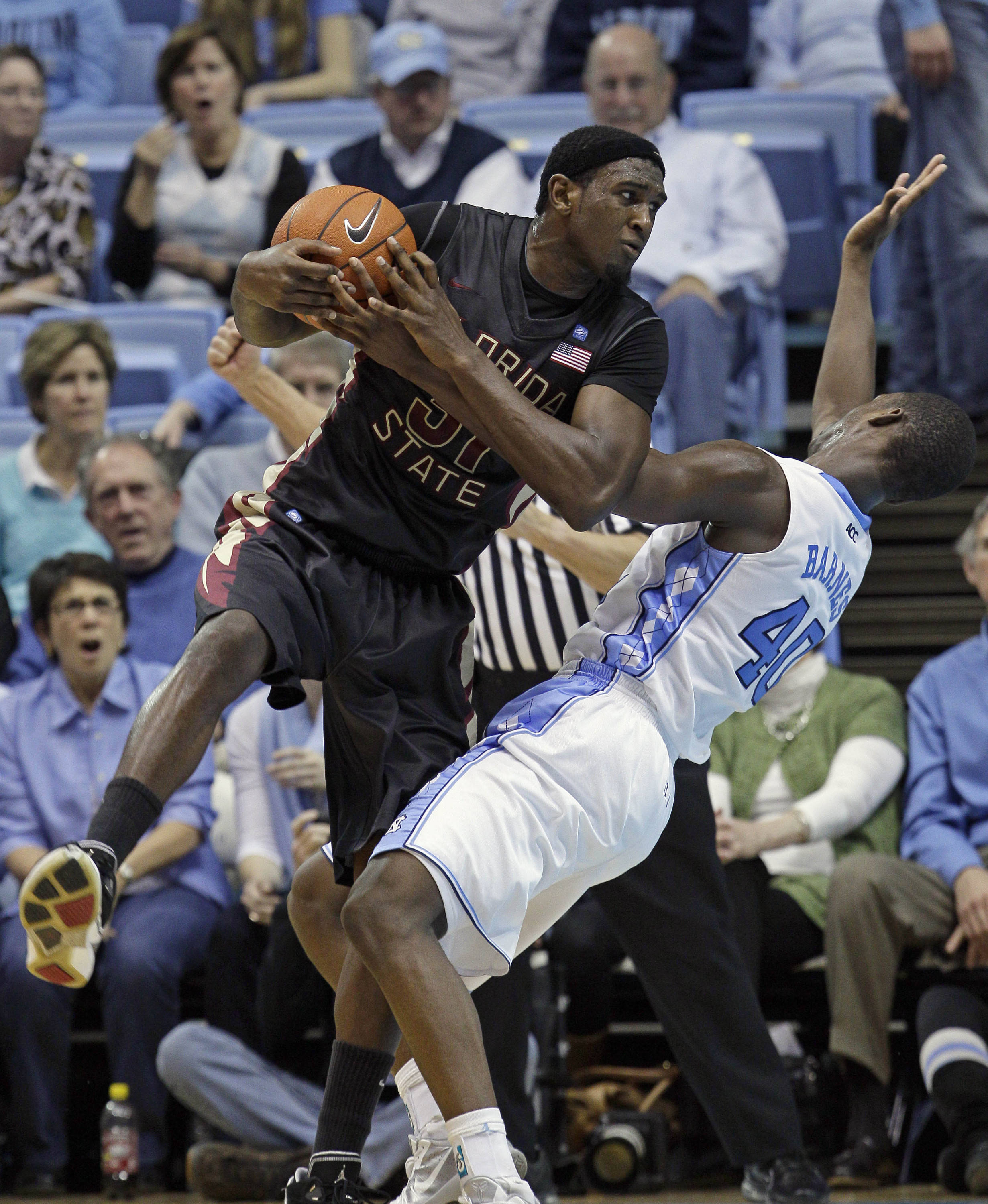 North Carolina's Harrison Barnes (40) and Florida State's Chris Singleton (31) collide during the second half of an NCAA college basketball game, Sunday, Feb. 6, 2011, in Chapel Hill, N.C. (AP Photo/Gerry Broome)