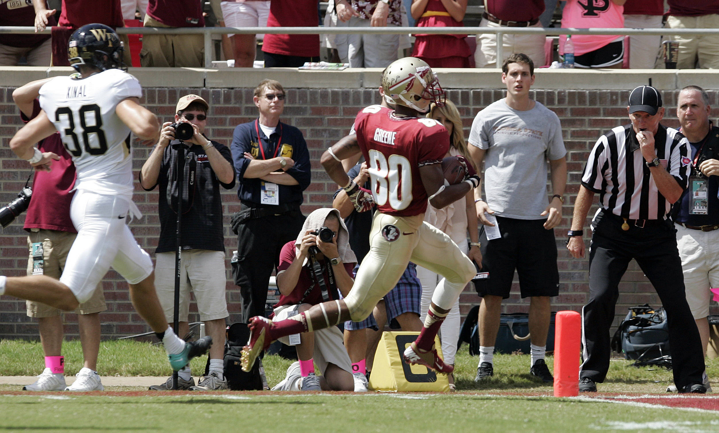 Florida State's Rashad Greene, right, runs past Wake Forest's Alex Kinal to score on a punt return. (AP Photo/Steve Cannon)