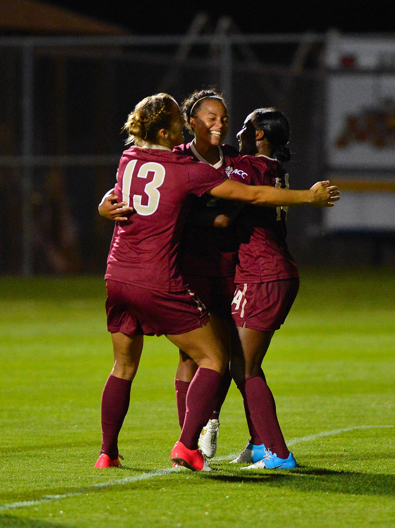 Kristin Grubka and Tiffany McCarty celebrate with Ines Jaurena on her game-winner in the 87th minute.