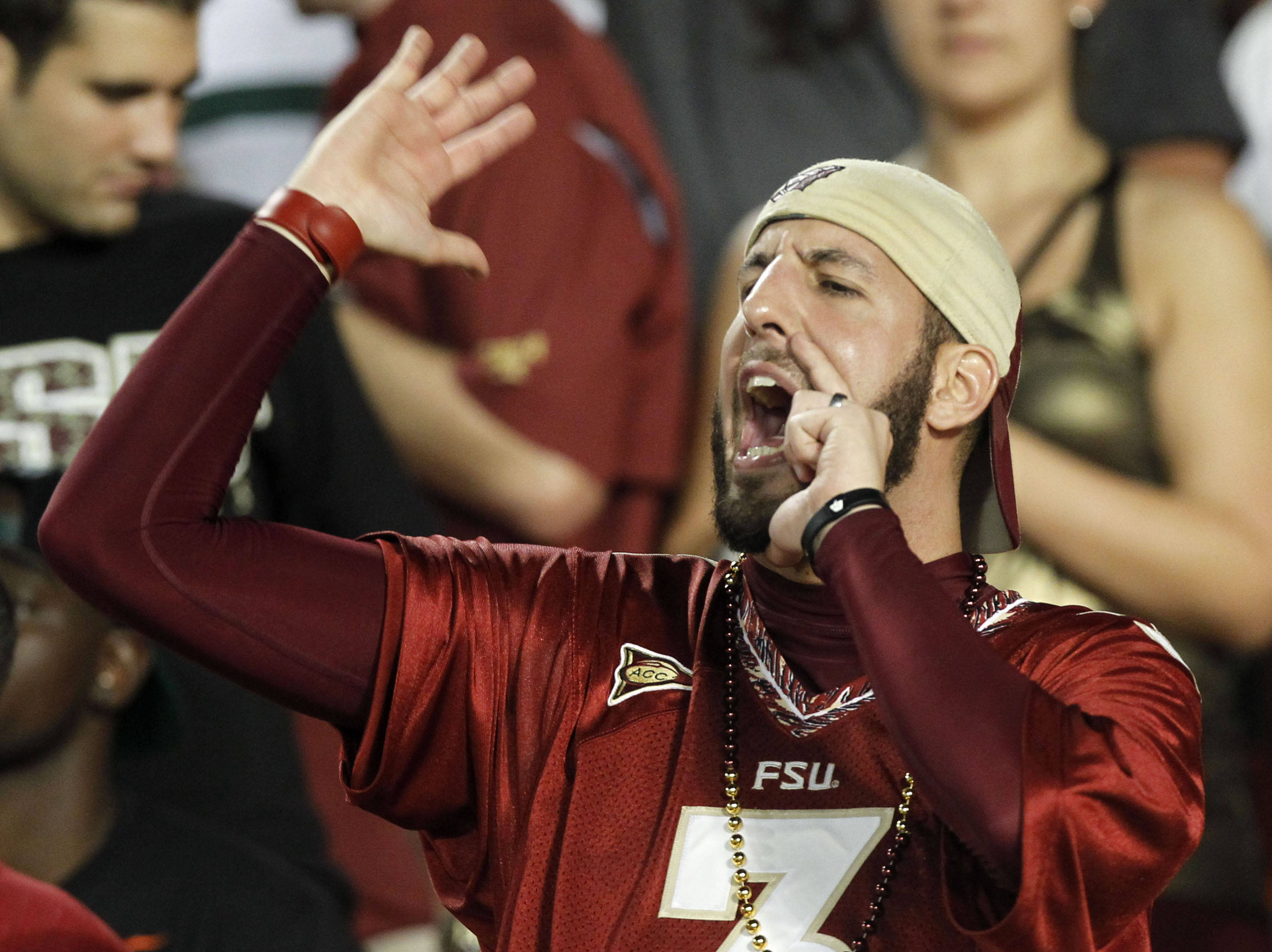 A fan cheers for Florida State during the game. (AP Photo/Alan Diaz)