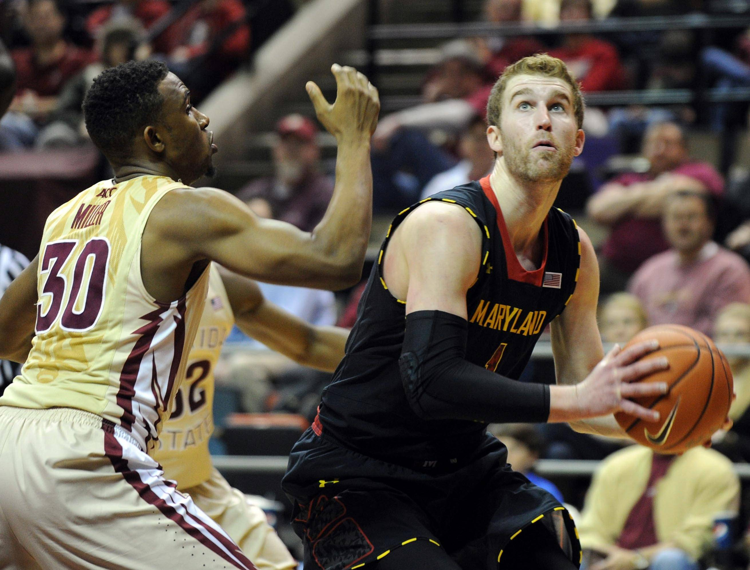 Jan 12, 2014; Tallahassee, FL, USA; Florida State Seminoles guard Ian Miller (30) defends Maryland Terrapins forward Evan Smotrycz (1) during the second half at Donald L. Tucker Center. Mandatory Credit: Melina Vastola-USA TODAY Sports