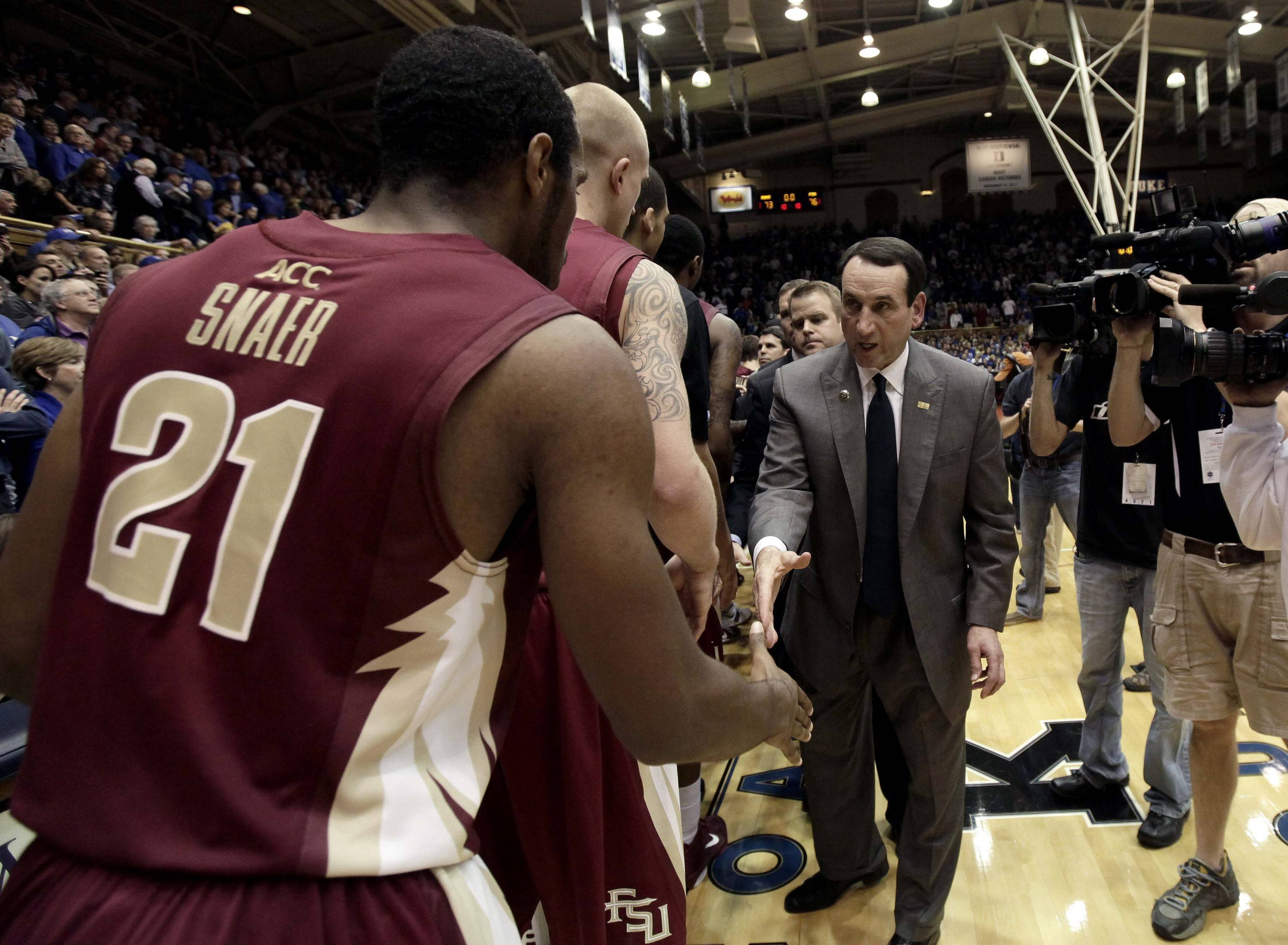 Duke coach Mike Krzyzewski, right, congratulates Florida State's Michael Snaer (21) following the game. (AP Photo/Gerry Broome)
