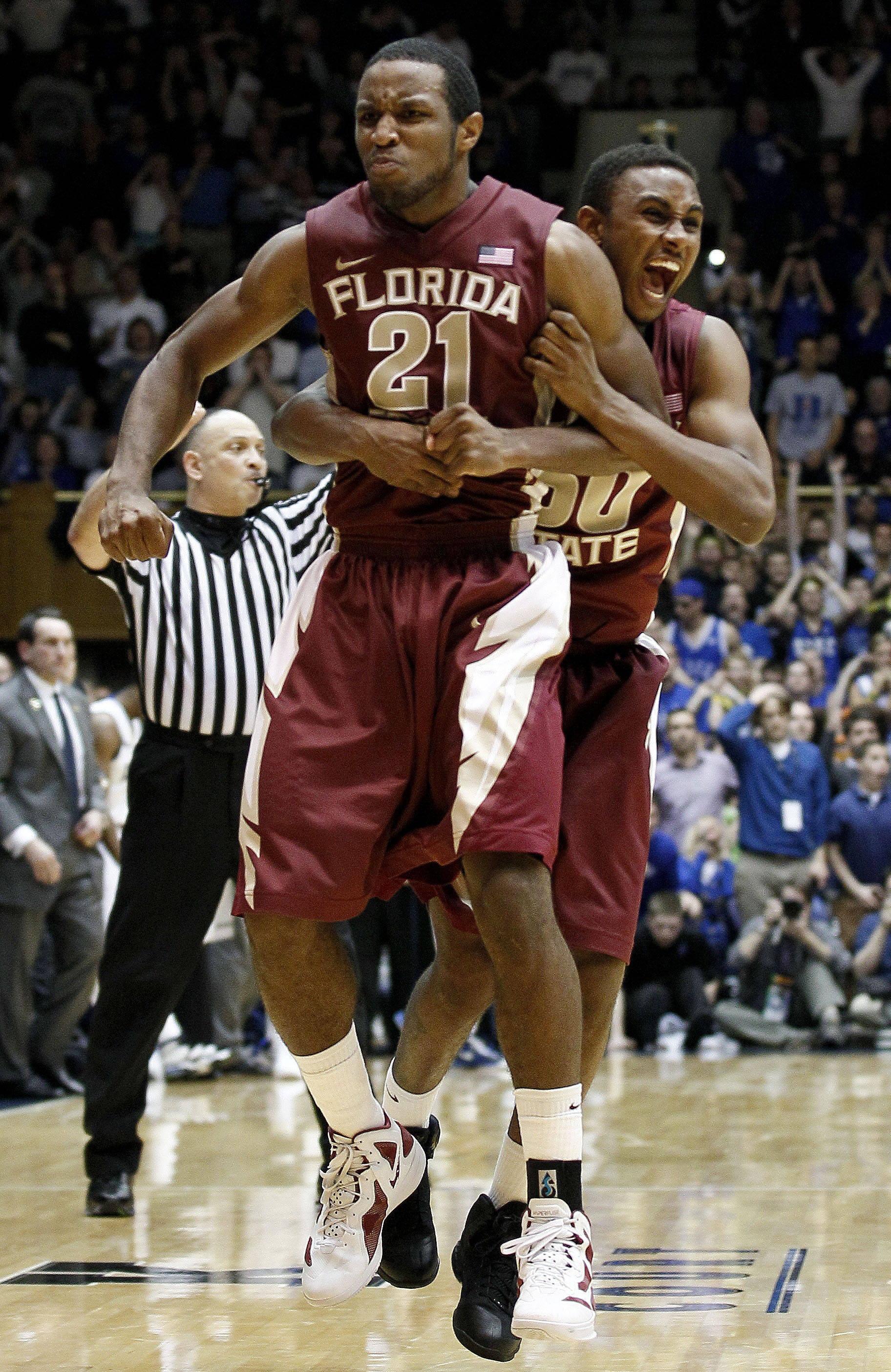 Florida State's Michael Snaer (21) and Ian Miller celebrate Snaer's game-winning shot against Duke during the second half. (AP Photo/Gerry Broome)