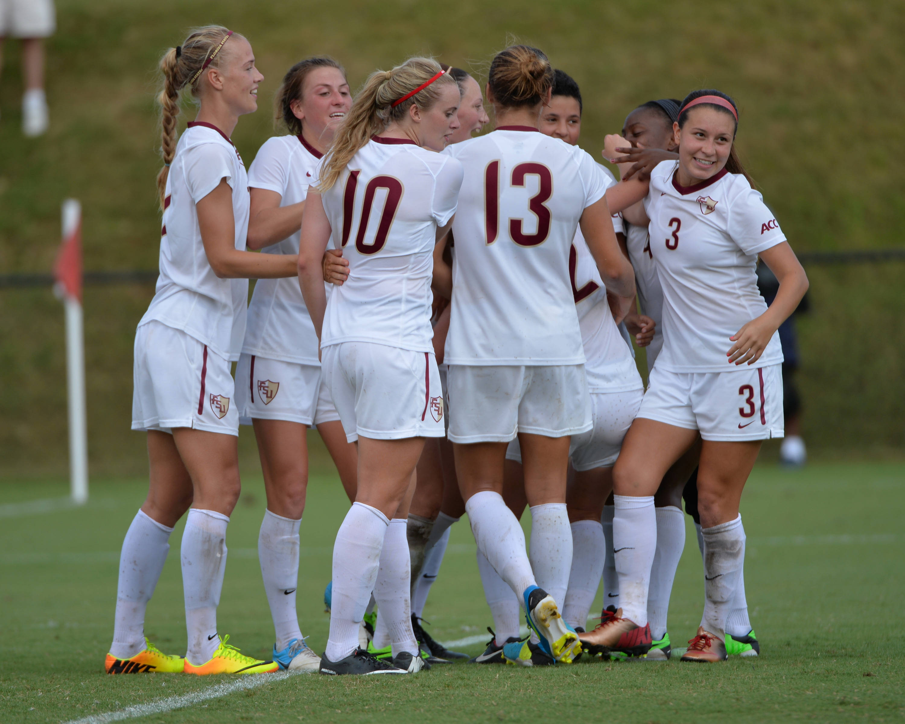 The Seminoles celebrate after Kirsten Crowley scored the game-winning goal in overtime