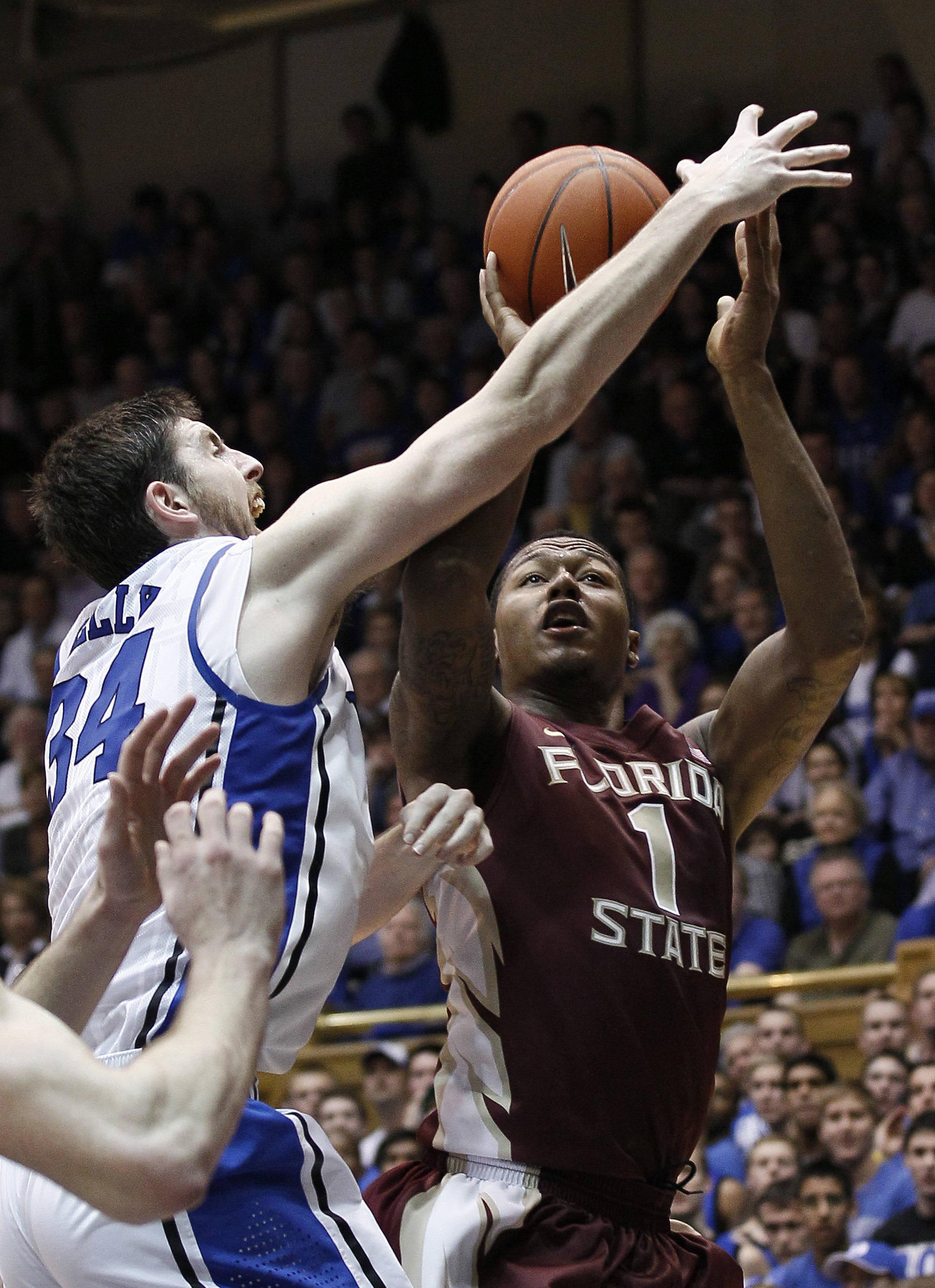 Duke's Ryan Kelly, left, defends while Florida State's Xavier Gibson (1) shoots during the second half. (AP Photo/Gerry Broome)