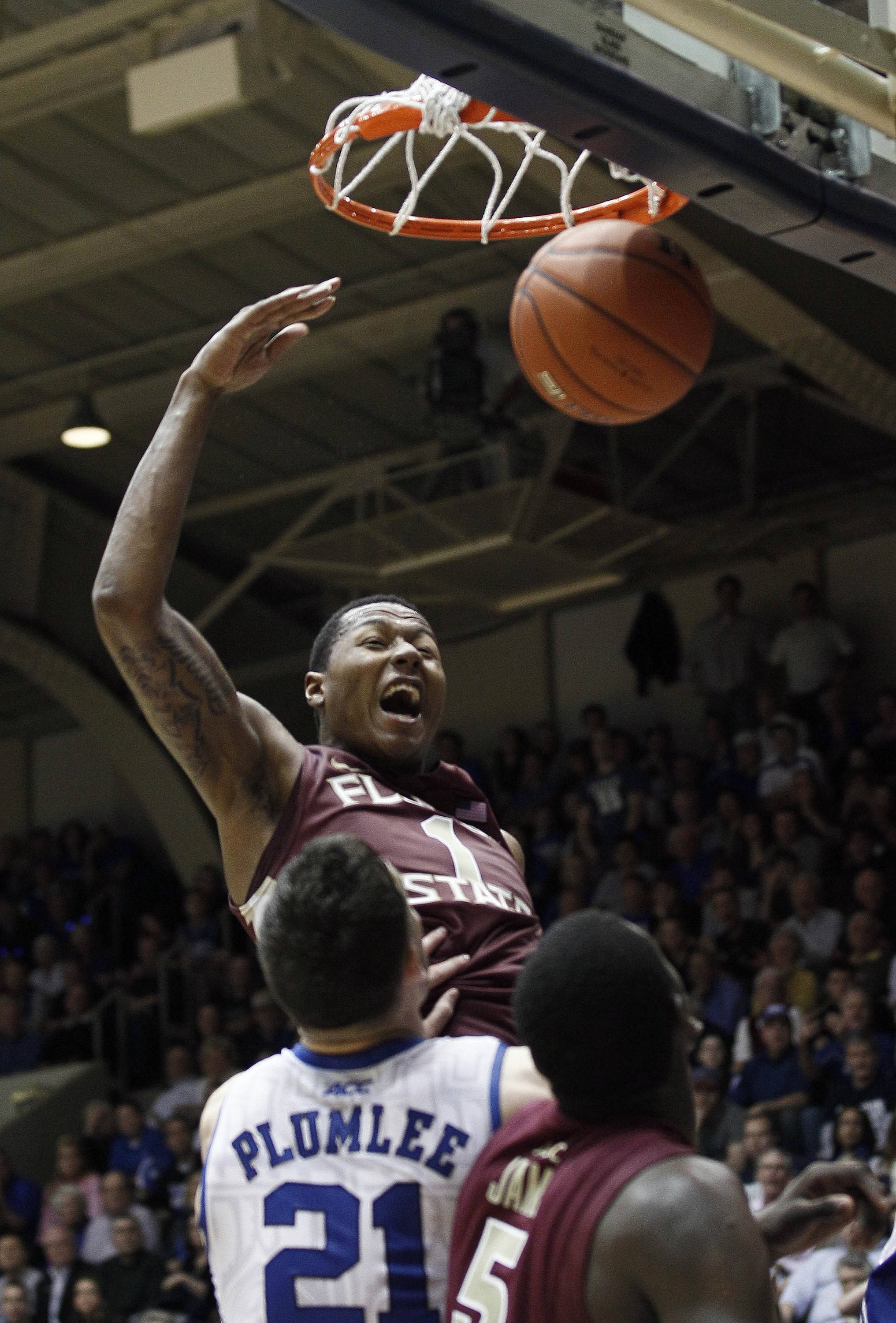 Florida State's Xavier Gibson (1) dunks as Duke's Miles Plumlee (21) watches during the second half. (AP Photo/Gerry Broome)