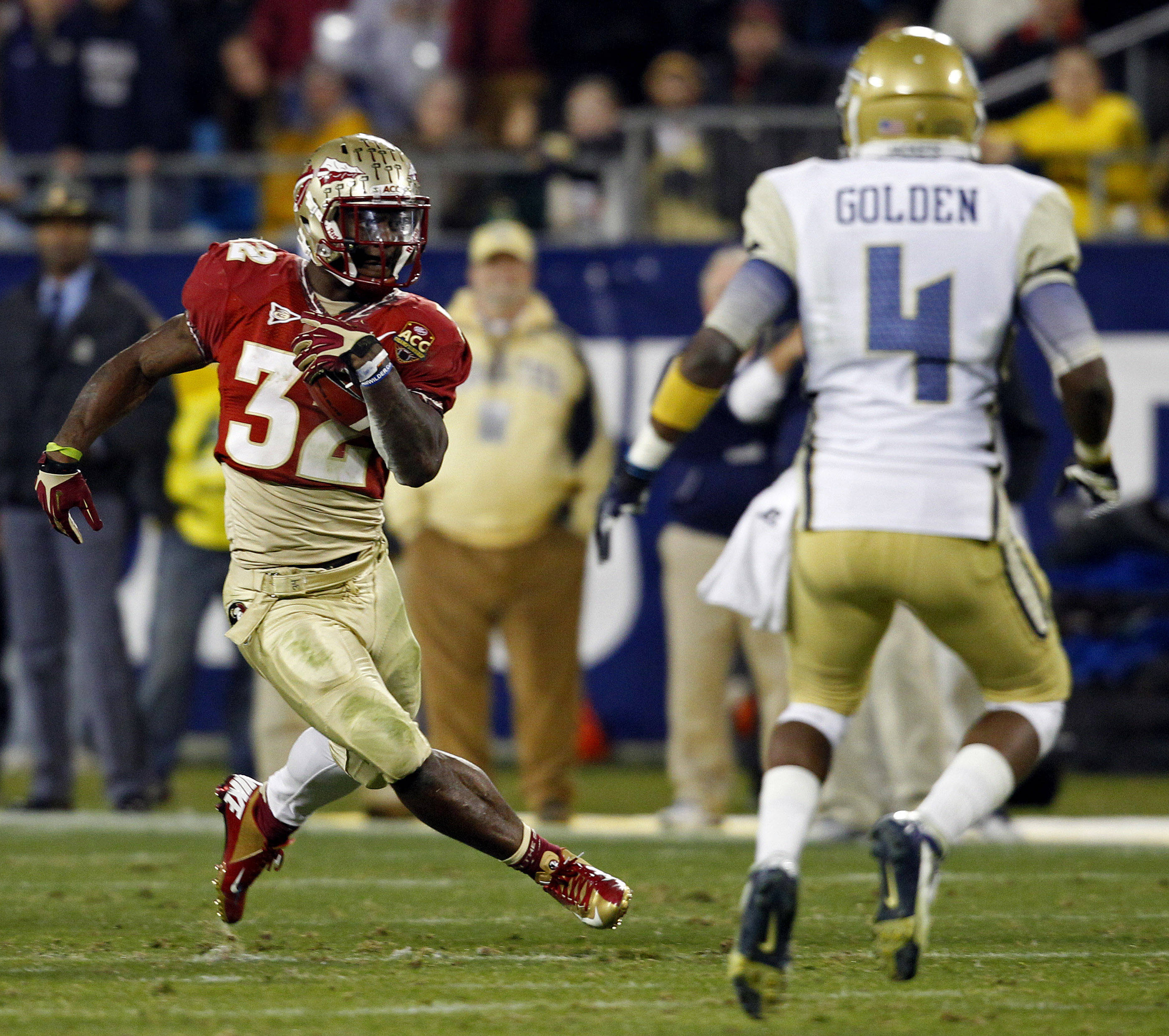 Florida State's James Wilder Jr. (32) carries as Georgia Tech's Jamal Golden (4) defends during the second half of the Atlantic Coast Conference championship NCAA college football game in Charlotte, N.C., Saturday, Dec. 1, 2012. (AP Photo/Chuck Burton)