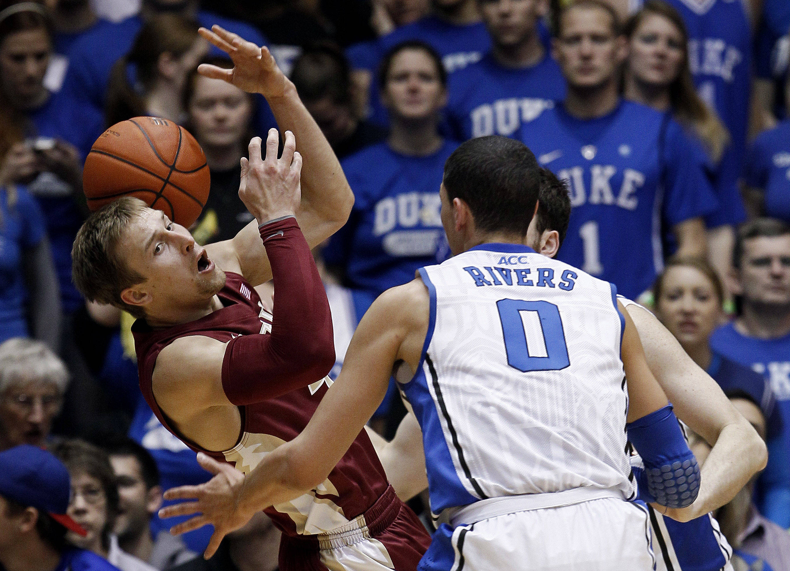 Florida State's Deividas Dulkys, left, tries to hold onto the ball as Duke's Austin Rivers (0) and Ryan Kelly, rear, apply pressure during the first half. (AP Photo/Gerry Broome)