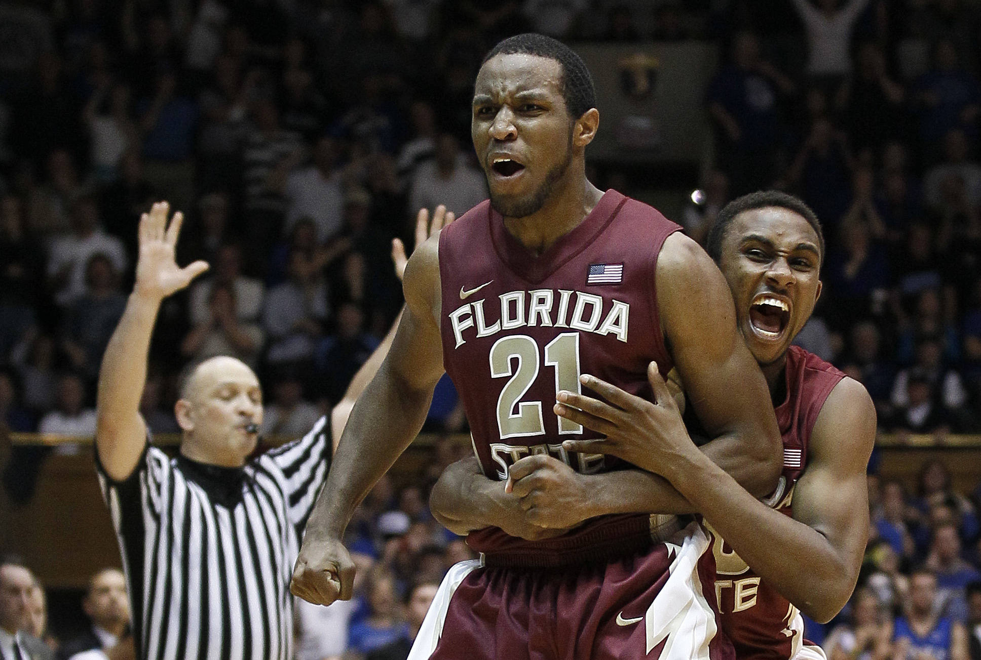 Florida State's Michael Snaer (21) and Ian Miller celebrate Snaer's game-winning basket against Duke during the second half. (AP Photo/Gerry Broome)