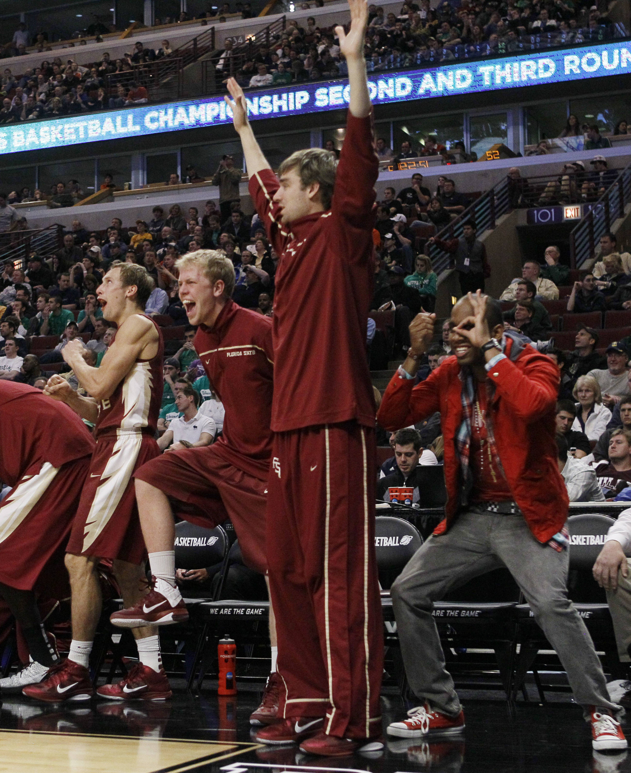 Florida State bench react in the second half. (AP Photo/Charles Rex Arbogast)