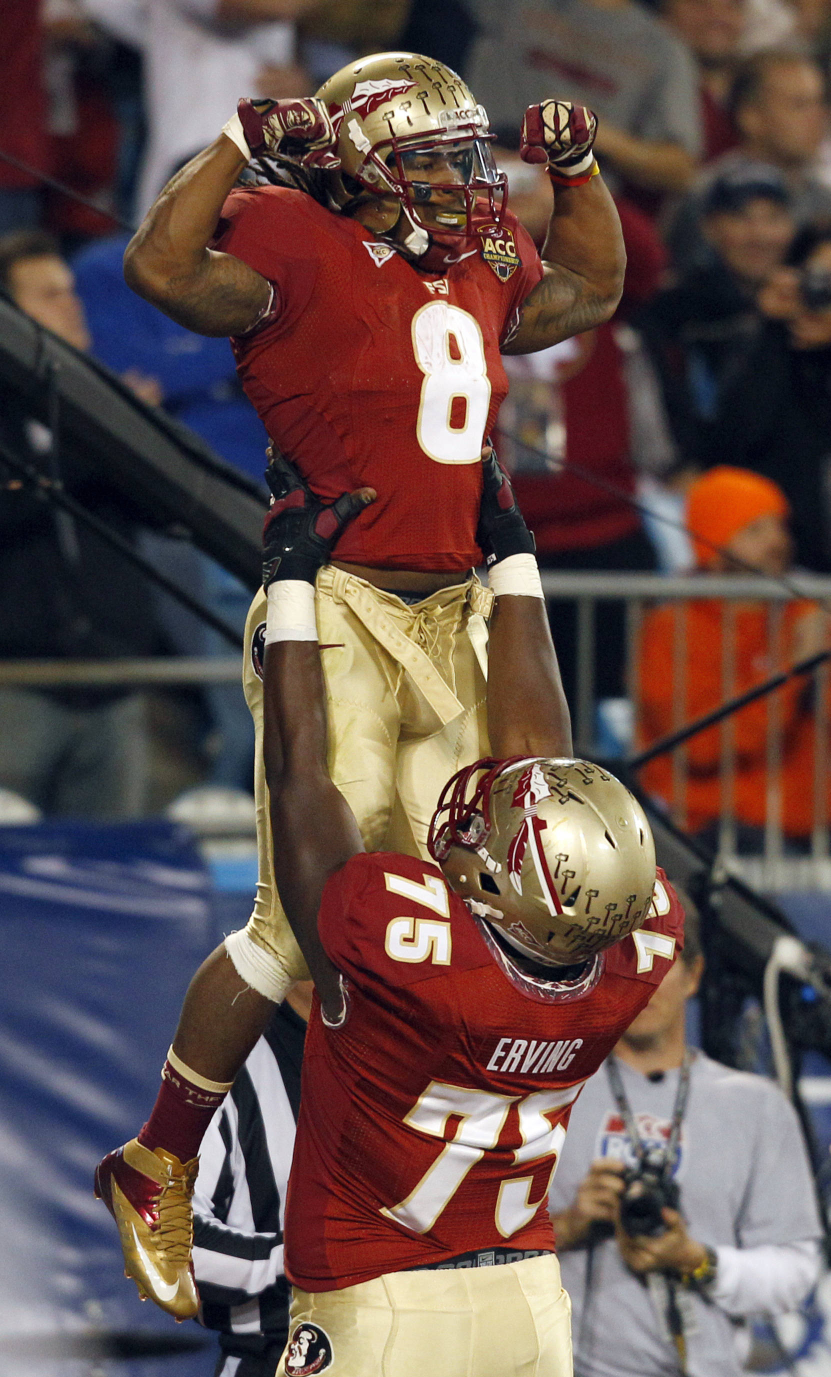 Florida State's Devonta Freeman (8) is lifted by teammate Cameron Erving (75) after his touchdown run against Georgia Tech during the first half. (AP Photo/Chuck Burton)