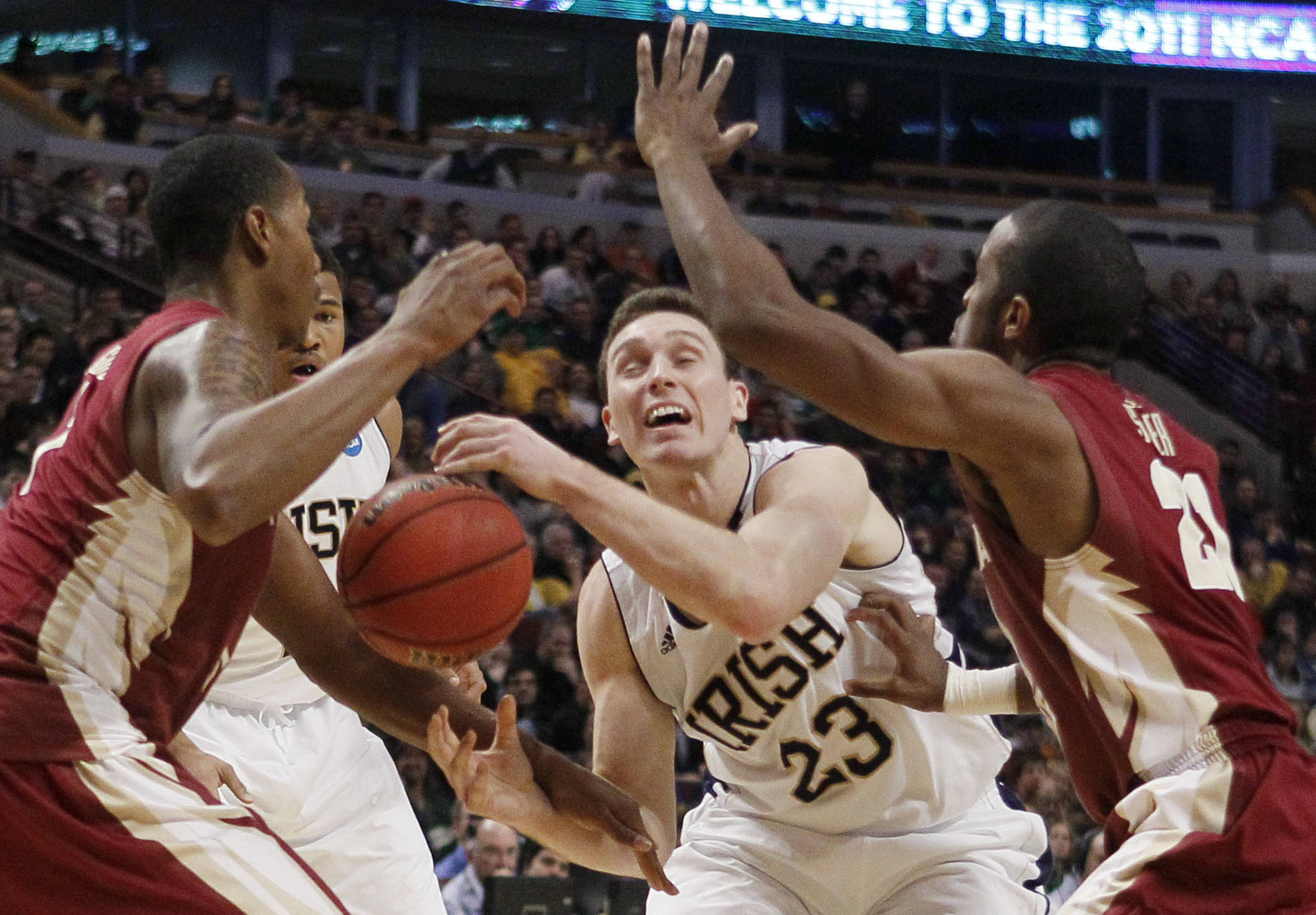 Notre Dame guard Ben Hansbrough (23) loses the control of the ball against Florida State forward/center Xavier Gibson, left, and guard Michael Snaer (21). (AP Photo/Charles Rex Arbogast)
