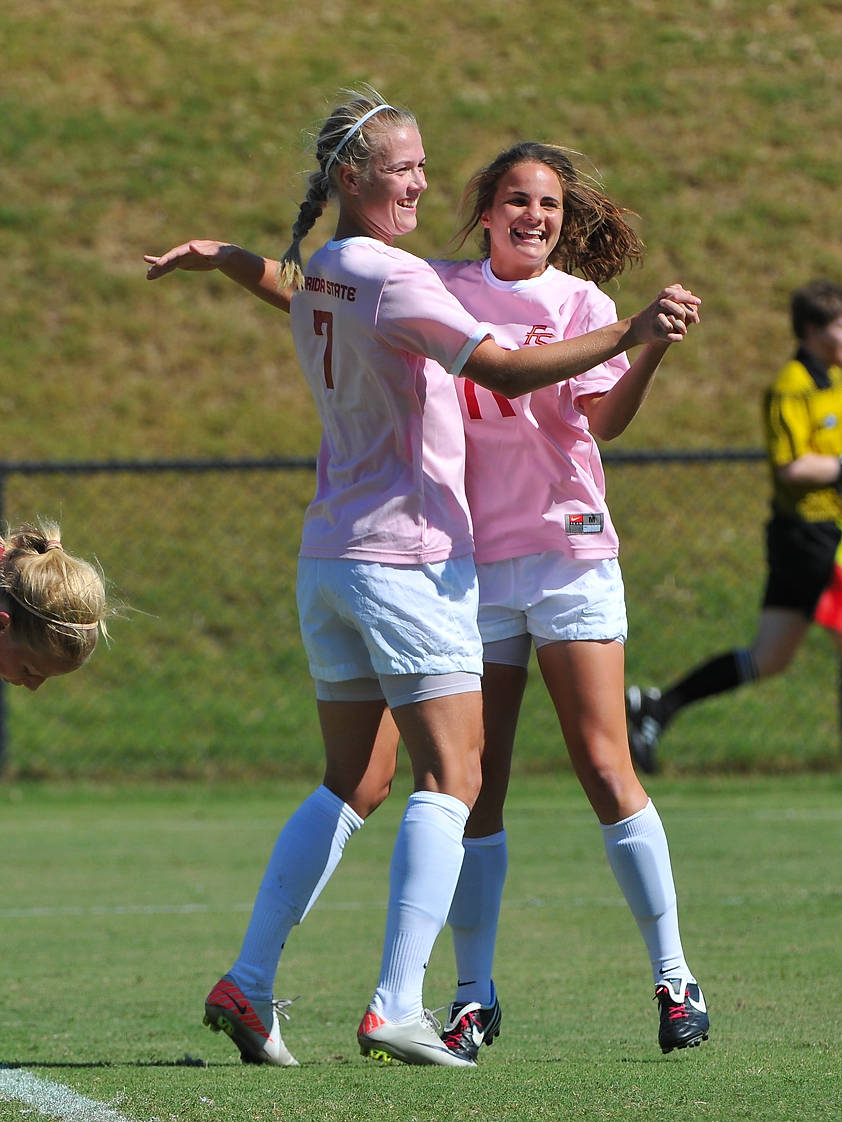 Dagny Brynjarsdottir and Katie Riley celebrate after connecting on a the game-winner in the 84th minute against Boston College.