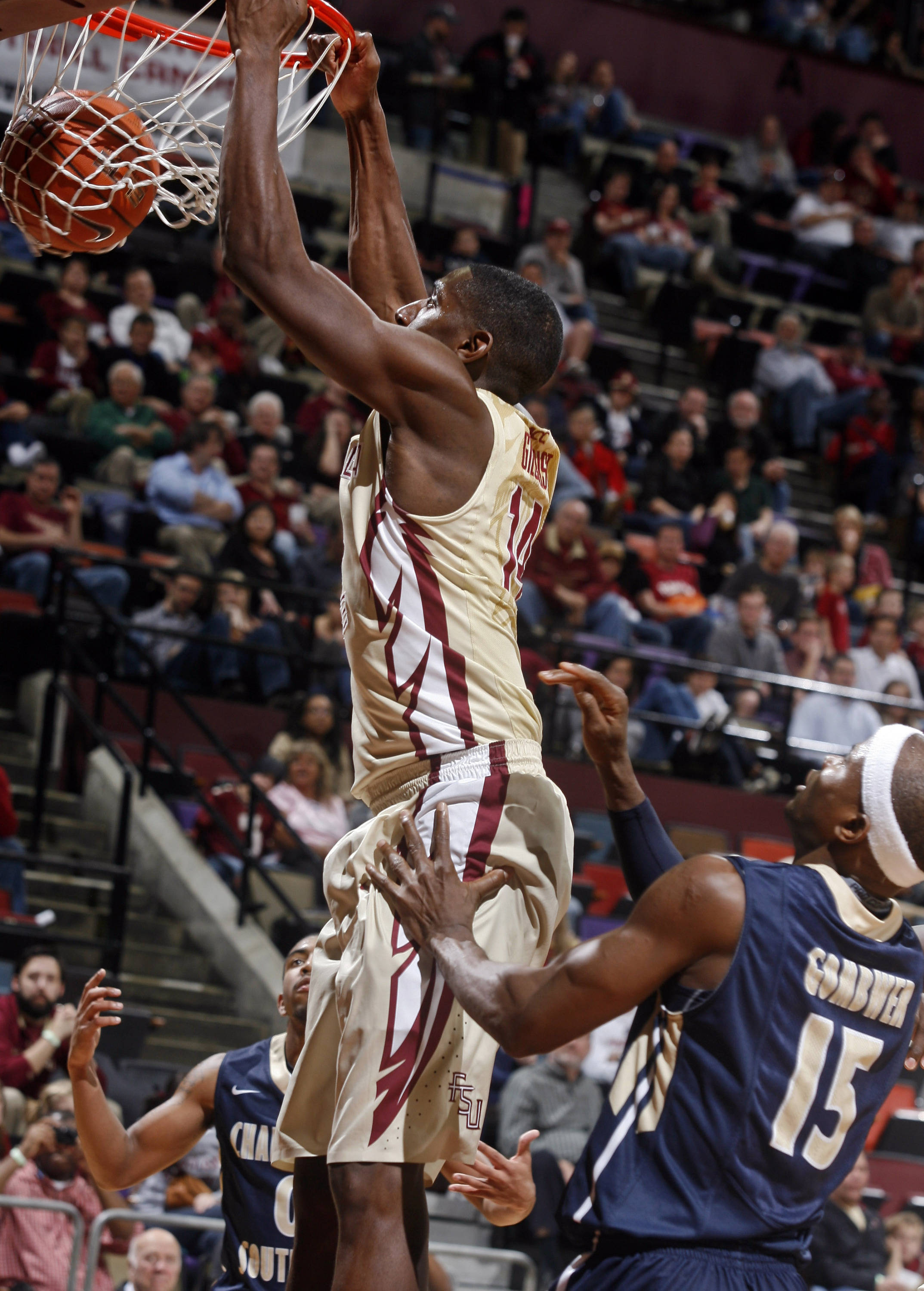 Florida State Seminoles forward Robert Gilchrist (14) dunks as Charleston Southern Buccaneers forward Paul Gombwer (15) watches in the second half. (Phil Sears-USA TODAY Sports)