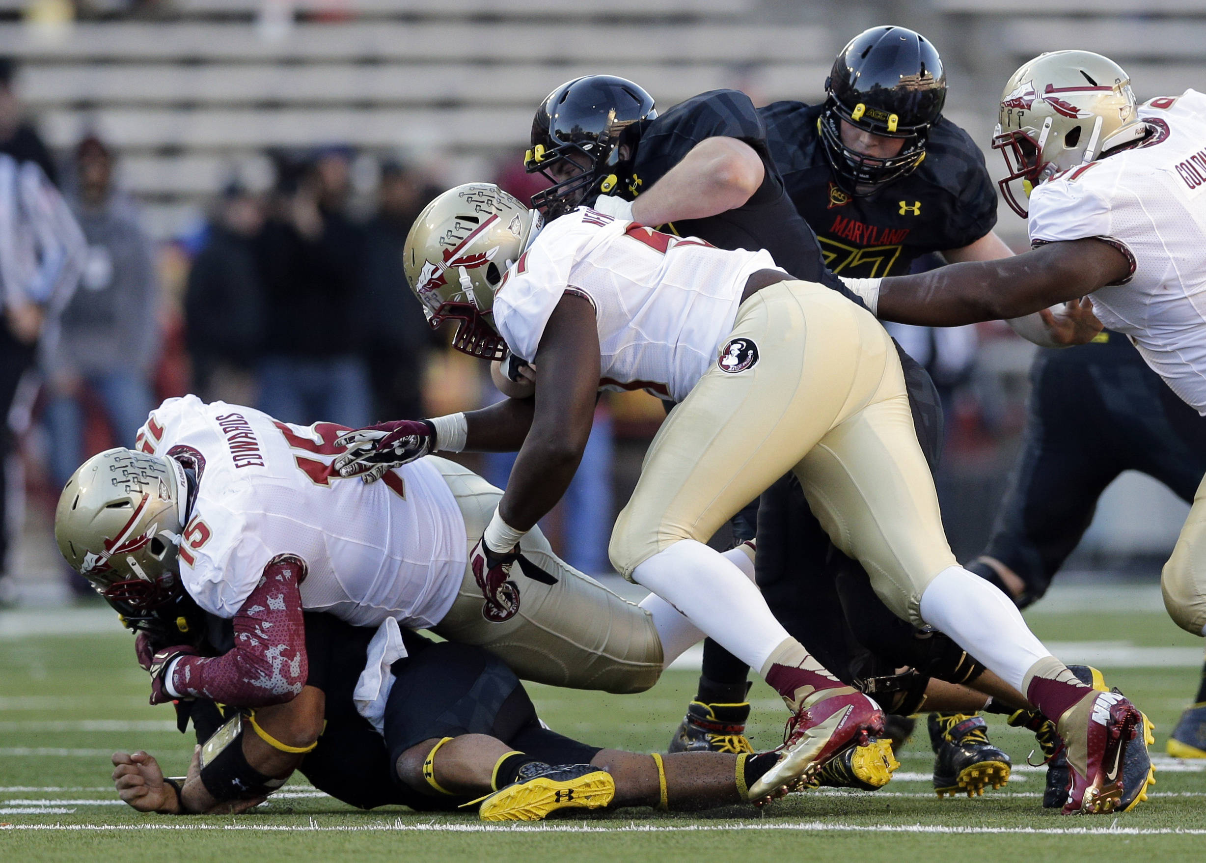 Maryland quarterback Shawn Petty, bottom left, is sacked by defensive end Mario Edwards, Jr. (15) in the second half of an NCAA college football game in College Park, Md., Saturday, Nov. 17, 2012. Florida State won 41-14. (AP Photo/Patrick Semansky)