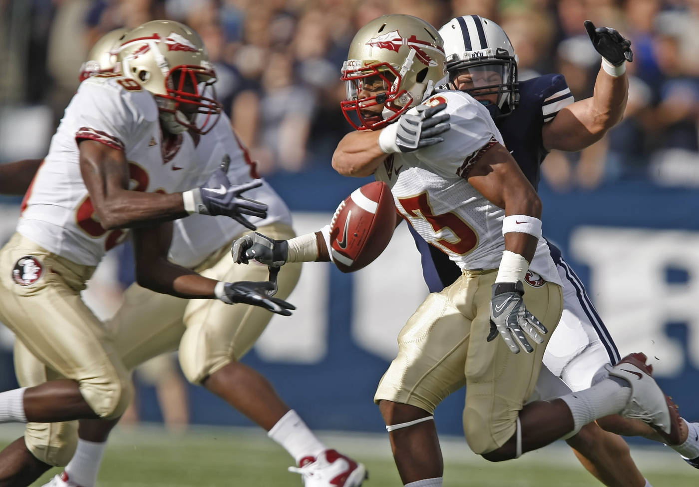 Florida State's Chris Thompson, right, pitches the ball to Louis Givens before being tackled by BYU's Jordan Pendleton during a NCAA football game at LaVell Edwards Stadium in Provo, Utah, Saturday, Sept. 19, 2009. (AP Photo/George Frey)