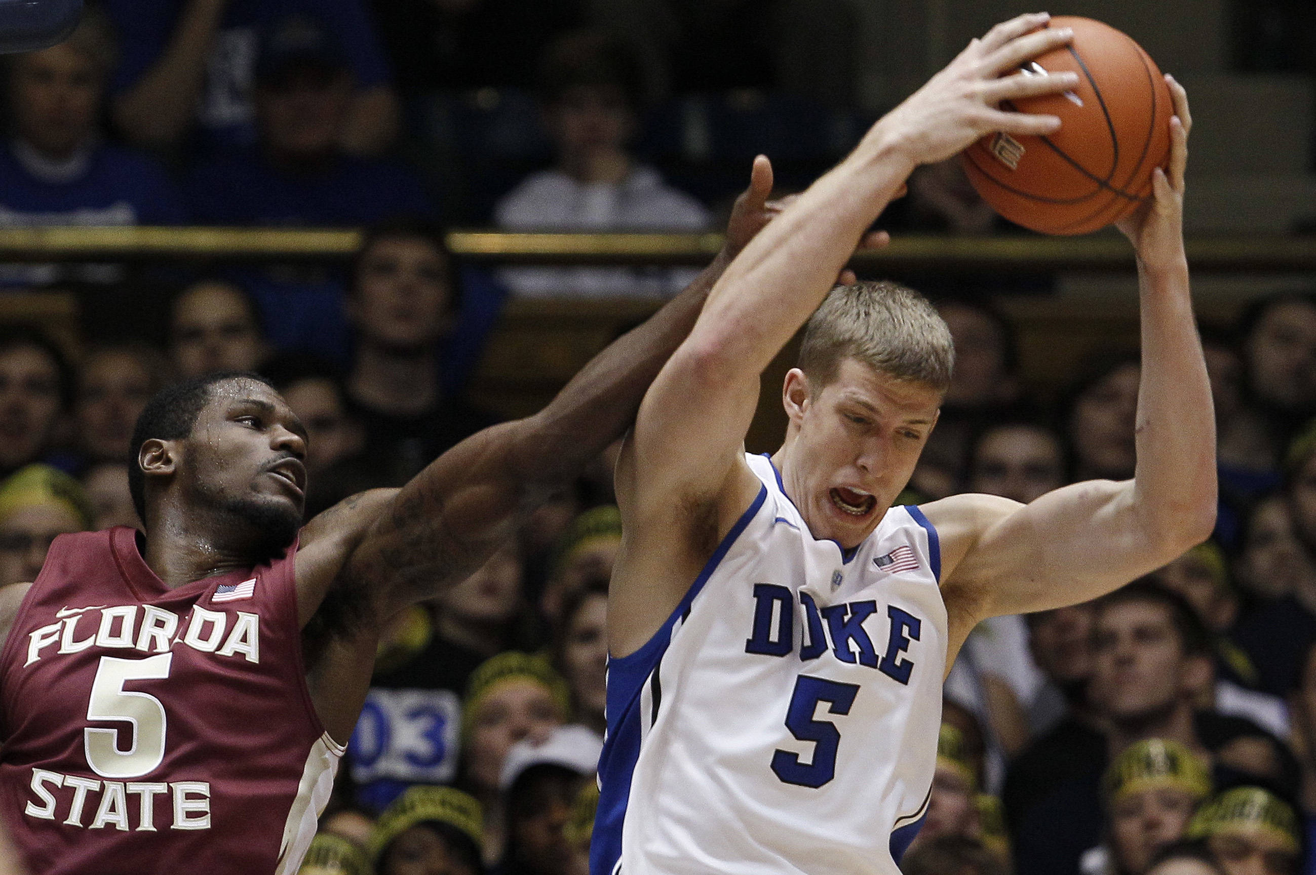 Florida State's Bernard James (5) and Duke's Mason Plumlee, right, struggle for a rebound during the first half. (AP Photo/Gerry Broome)