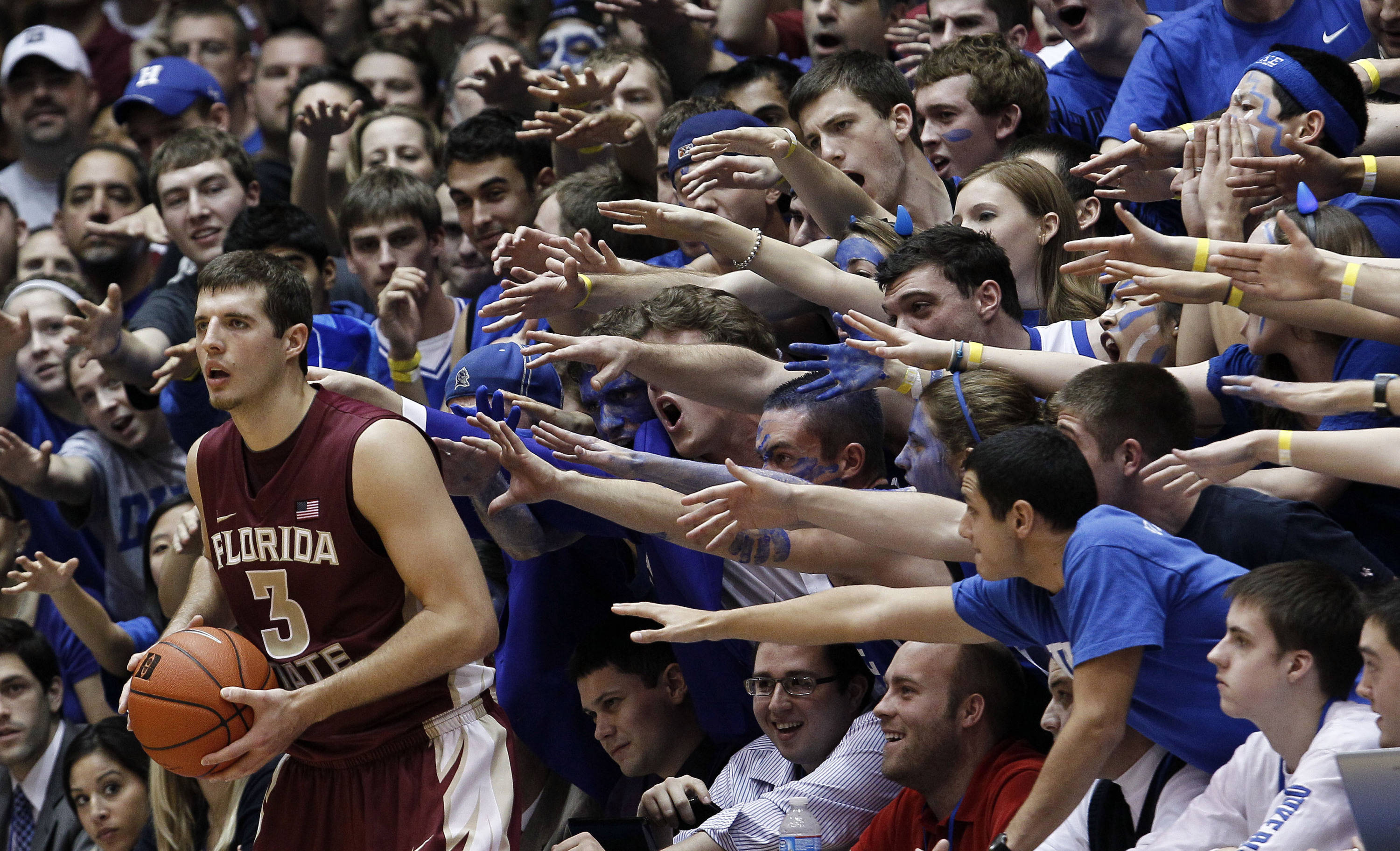 Duke fans reach for Florida State's Luke Loucks (3) as he in-bounds the ball against Duke during the second half. (AP Photo/Gerry Broome)