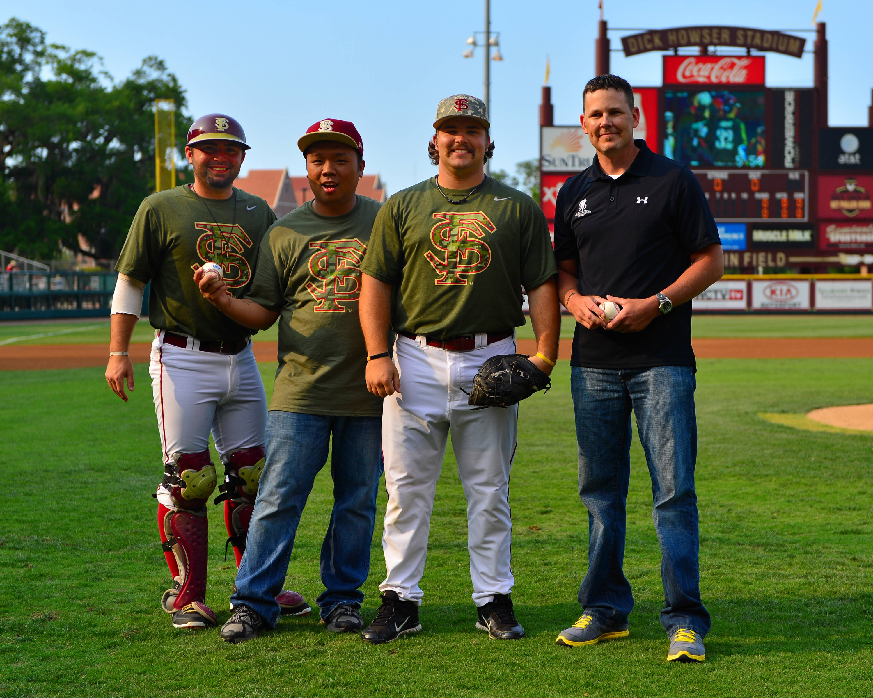 Ladson Montgomery and Scott Sitz with special first pitch members honoring the Seminole Student Veterans and Wounded Warrior Project.