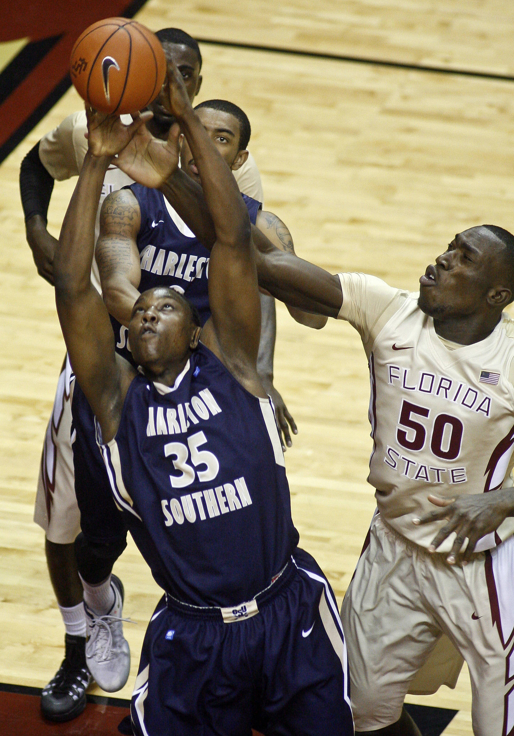 Charleston Southern Buccaneers forward/center Alhaji Fullah (35) fights for a rebound against Florida State Seminoles center Michael Ojo (50). (Phil Sears-USA TODAY Sports)