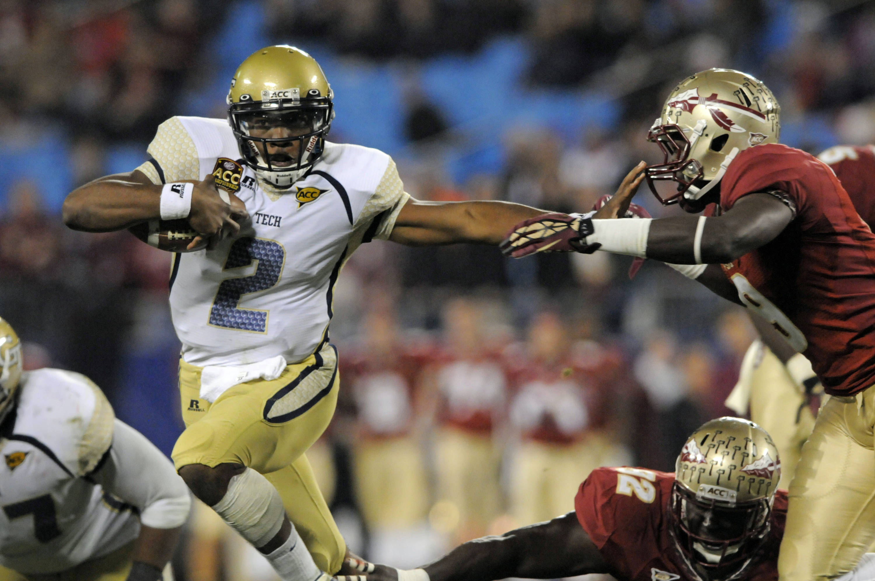 Georgia Tech's Vad Lee (2) tries to run past Florida State's Timmy Jernigan (8) during the first half of the ACC Championship college football game in Charlotte, N.C., Saturday, Dec. 1, 2012. (AP Photo/Mike McCarn)
