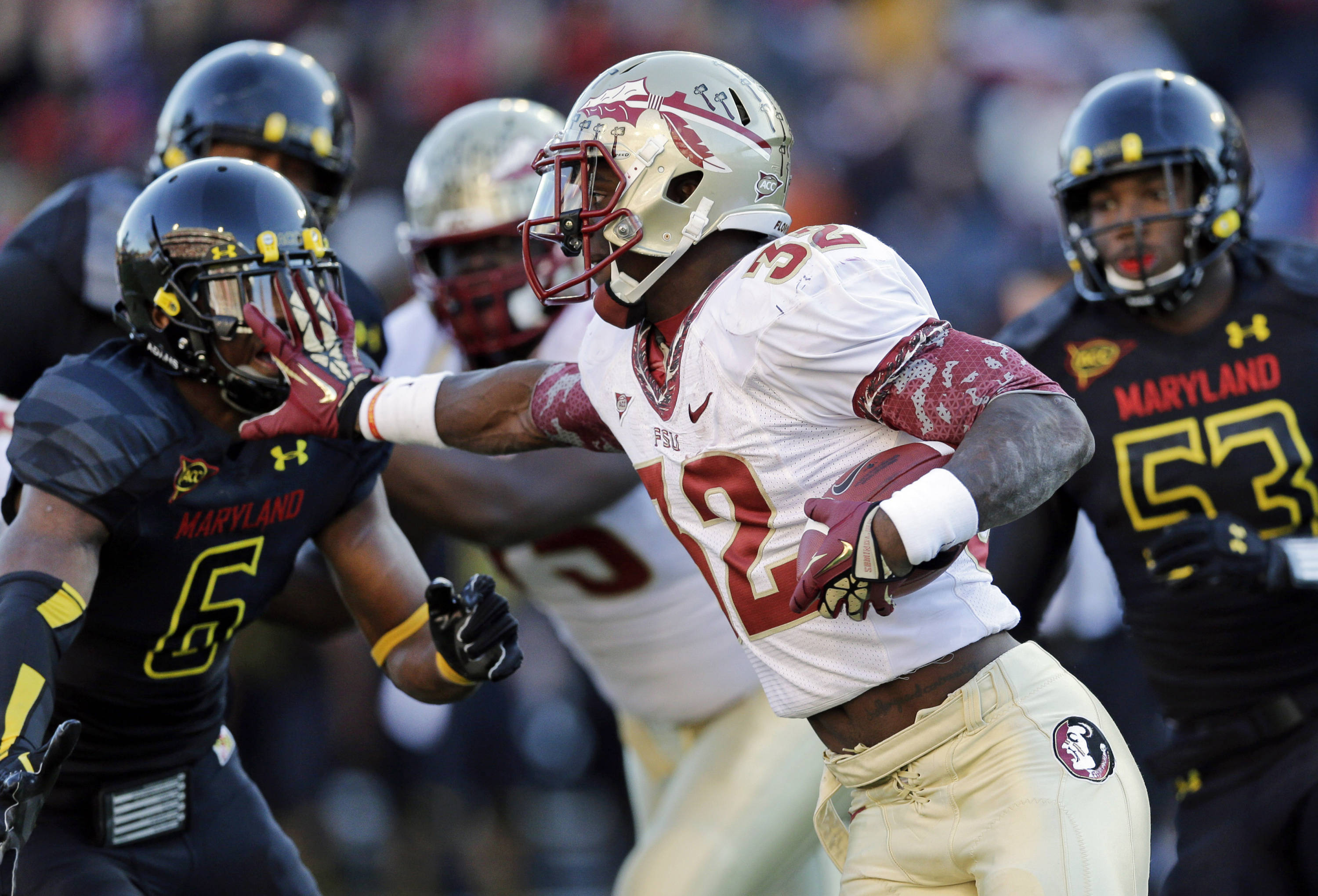 Running back James Wilder, Jr., center, rushes past Maryland linebackers Kenneth Tate (6) and L.A. Goree (53) in the second half of an NCAA college football game in College Park, Md., Saturday, Nov. 17, 2012. Florida State won 41-14. (AP Photo/Patrick Semansky)
