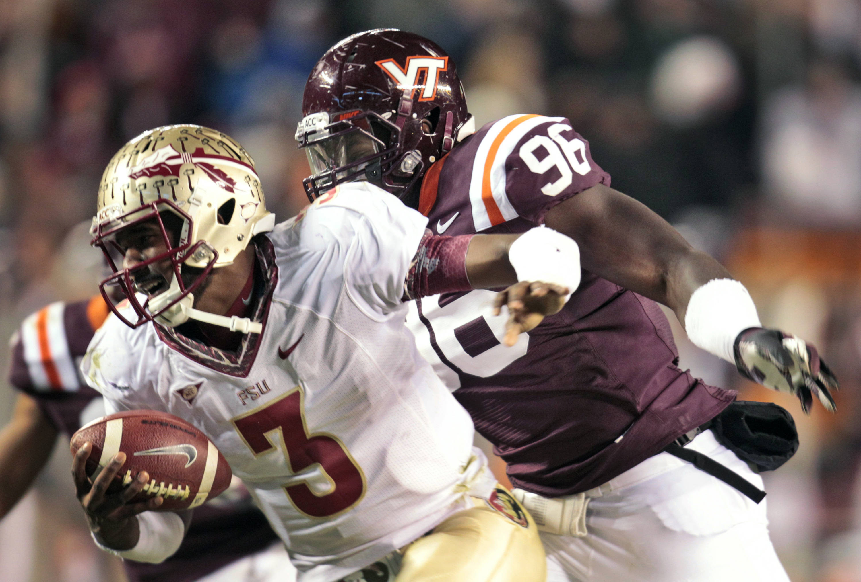 Florida State quarterback EJ Manuel (3) tries to get away from Virginia Tech defensive end Corey Marshall (96). (AP Photo/Steve Helber)