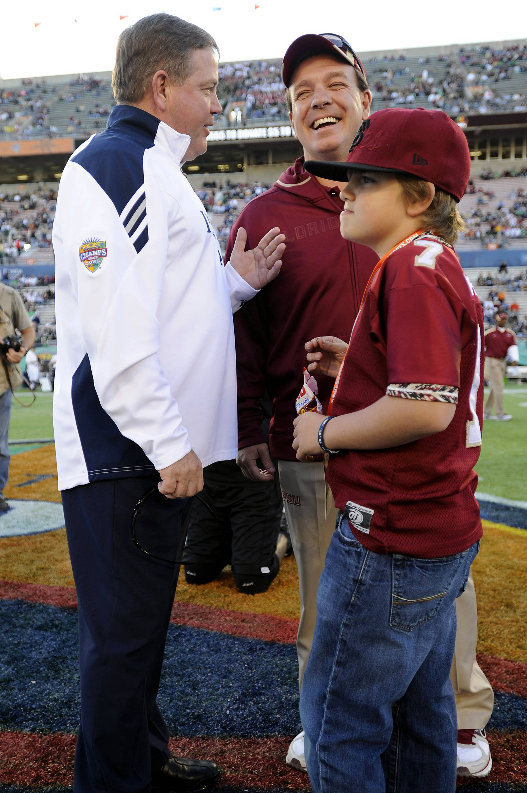 Jimbo Fisher and son Trey meet with Notre Dame Head Coach Brian Kelly