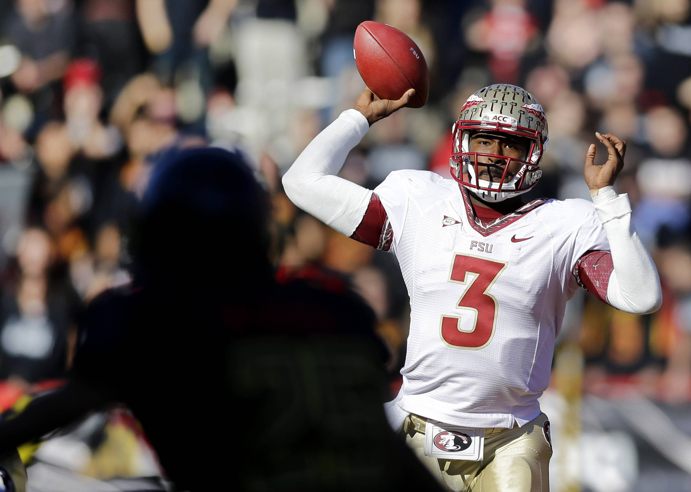 Quarterback EJ Manuel throws to a receiver in the first half of an NCAA college football game against Maryland in College Park, Md., Saturday, Nov. 17, 2012. (AP Photo/Patrick Semansky)