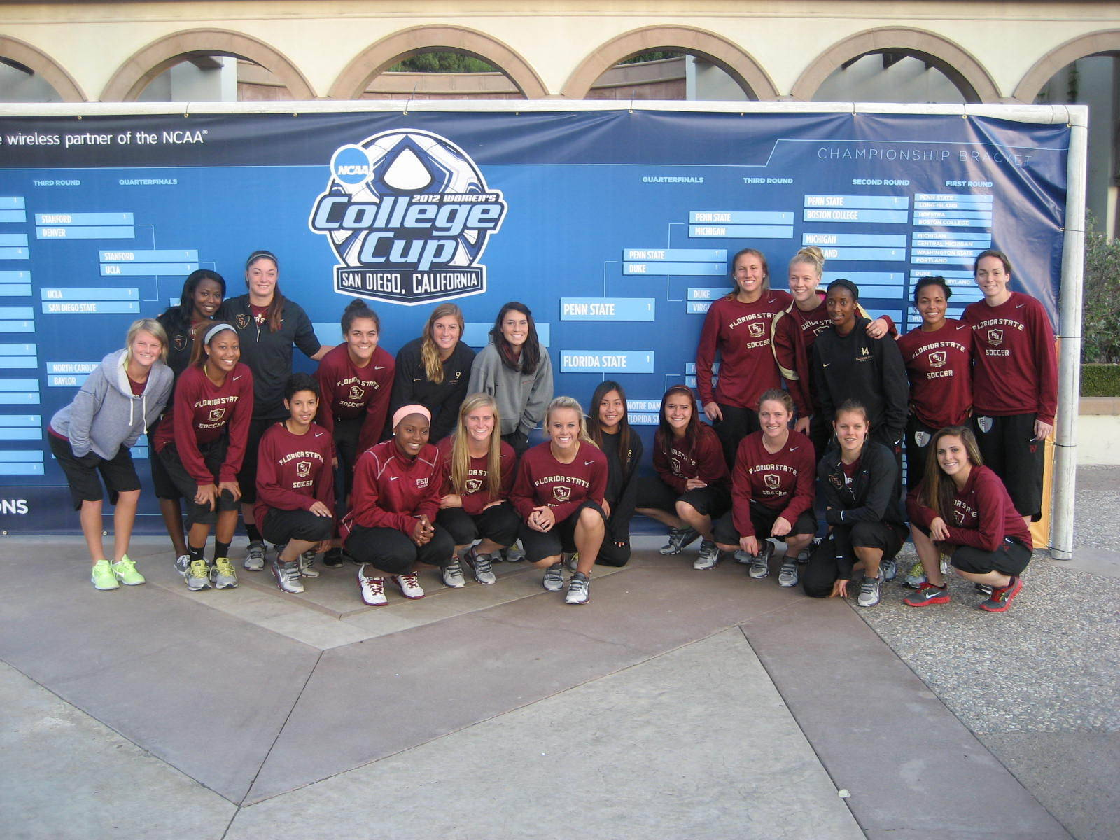 The 2012 Seminoles pose in front of a live sized bracket at Torero Stadium.