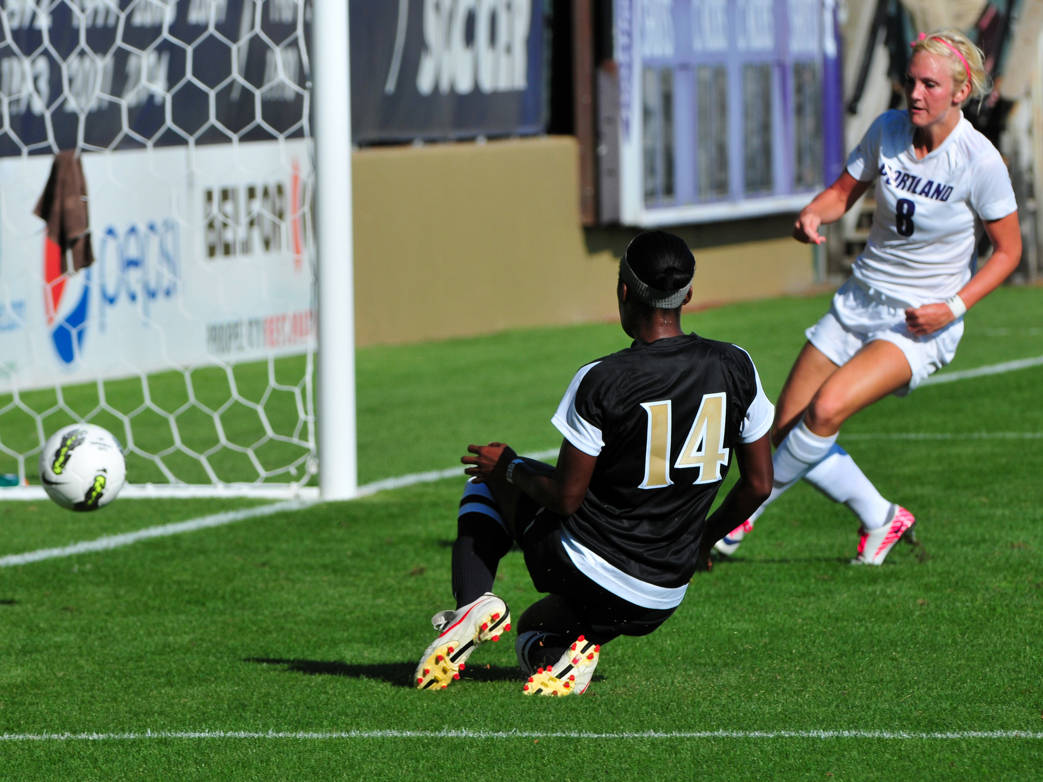 Tiffany McCarty finds the back of the net in the first half against Portland.
